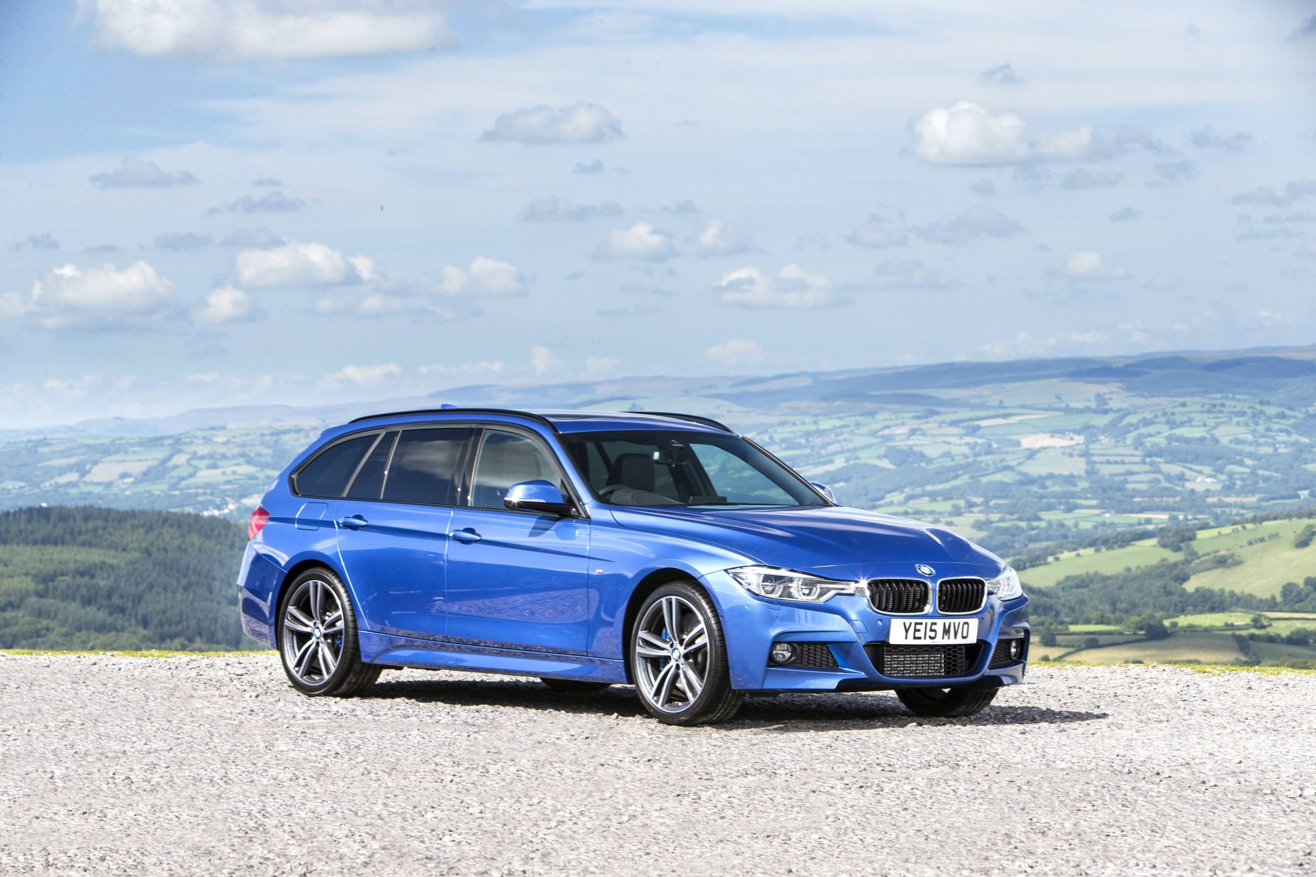 image of a blue bmw 3 series touring xdrive car exterior