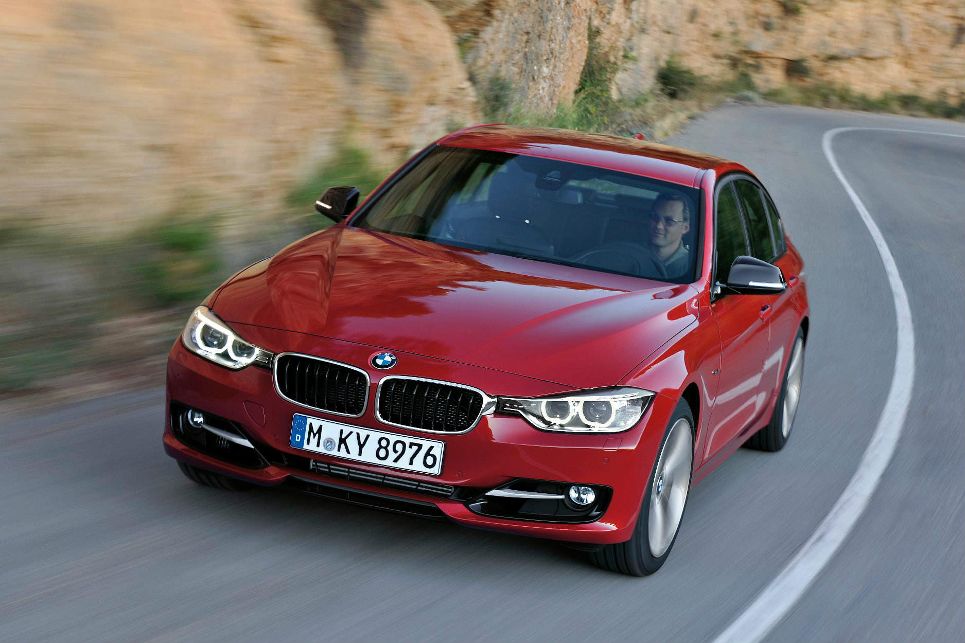 image of a red bmw 3 series car exterior