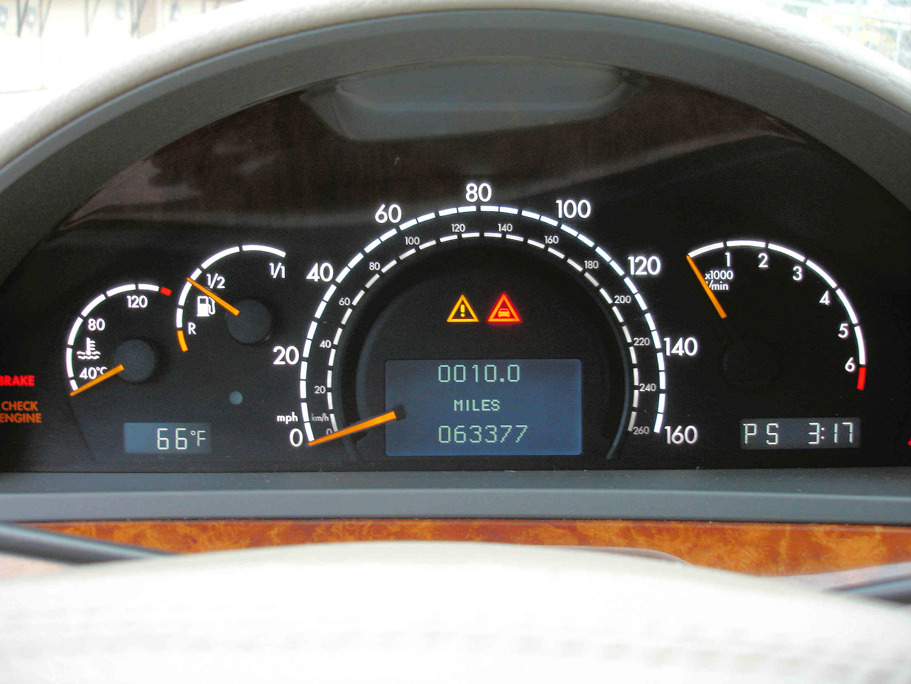 image of mileage and odometer on a car dashboard