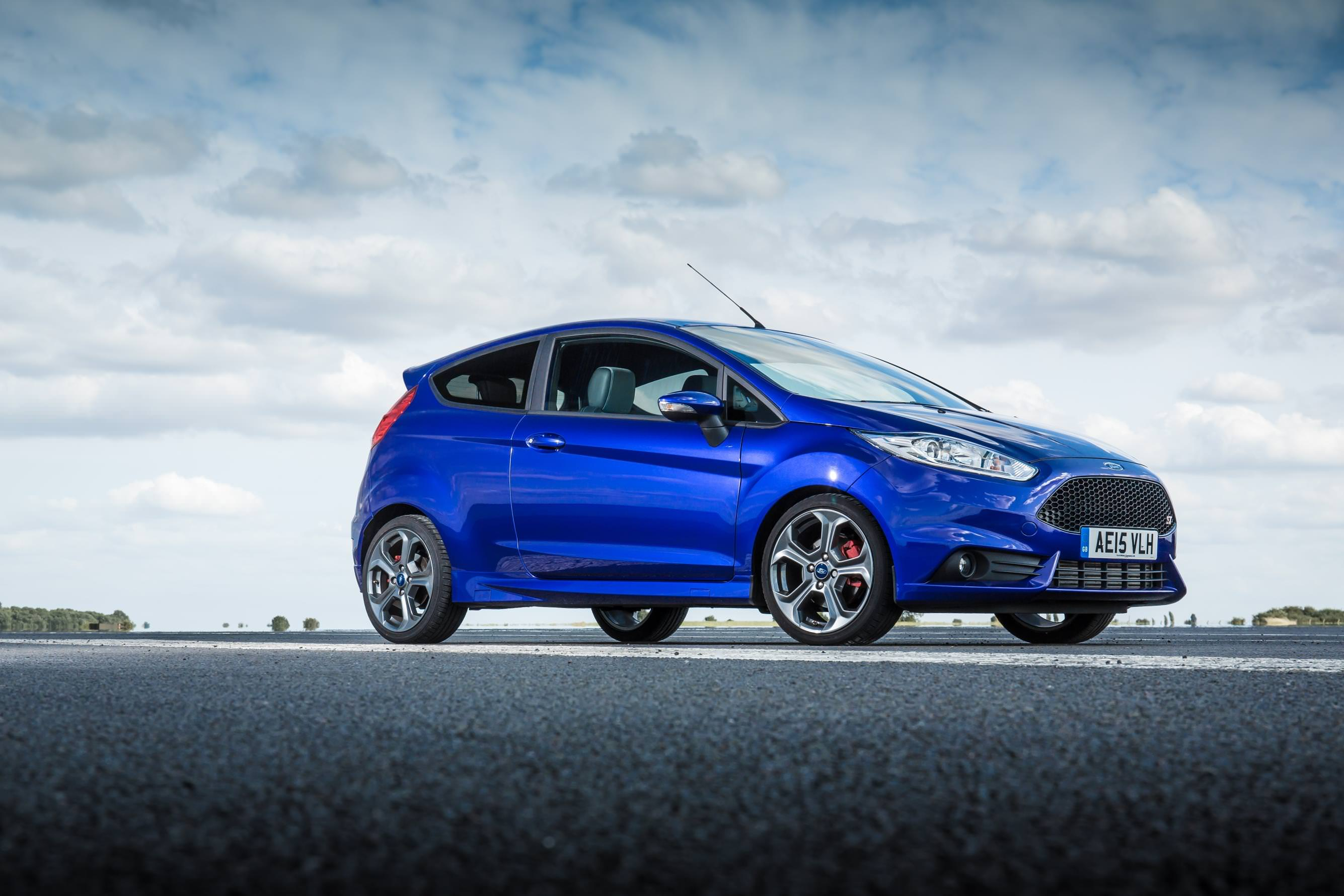 image of a blue ford fiesta st on an open road
