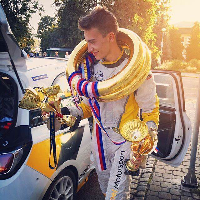 image of chris ingram rally driver with trophies