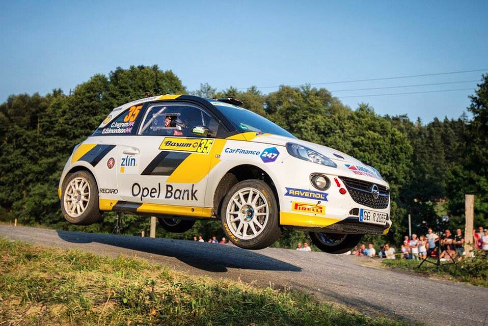 image of chris ingram rally car in mid air over a hill