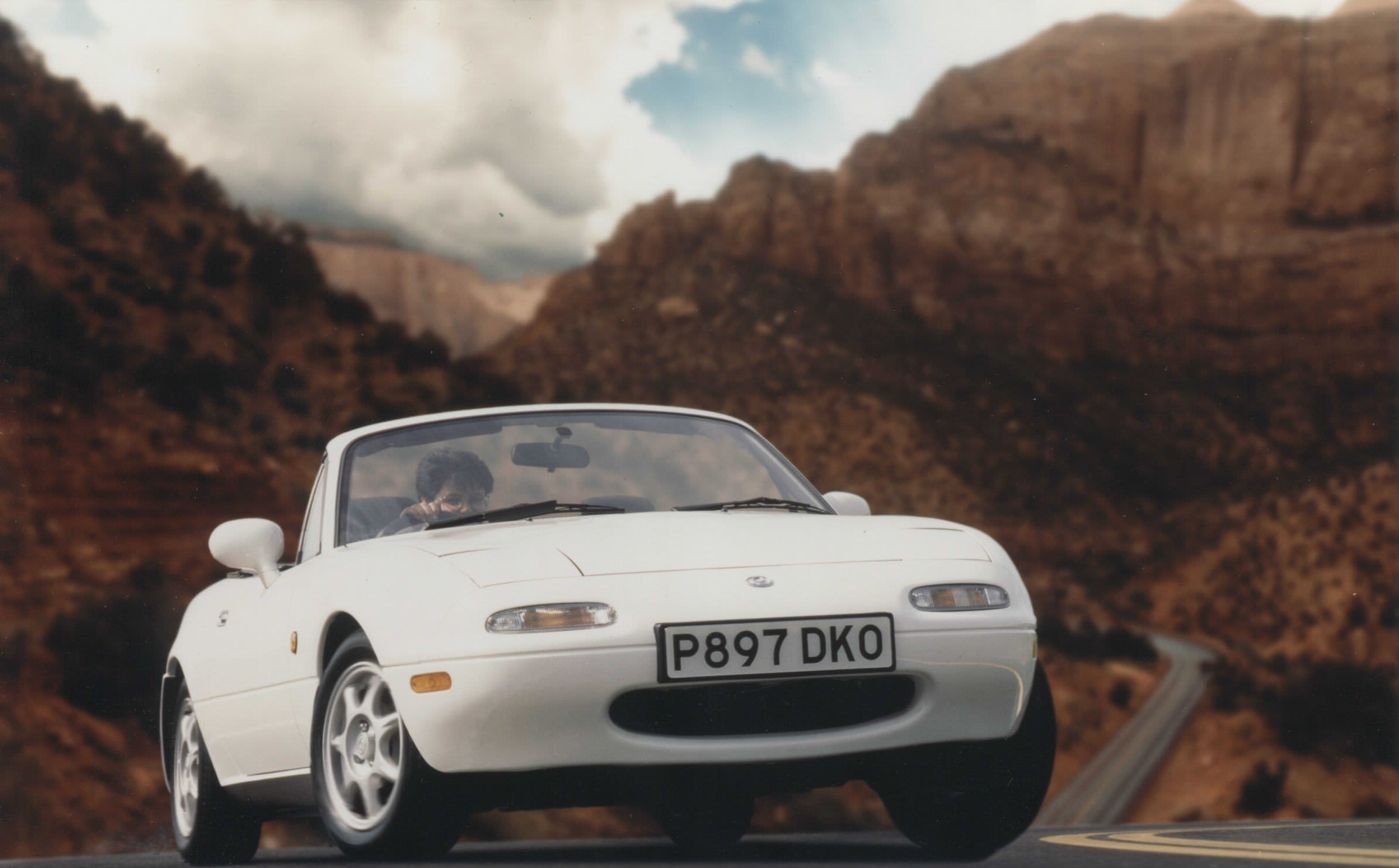image of a vintage white mazda mx 5 car exterior