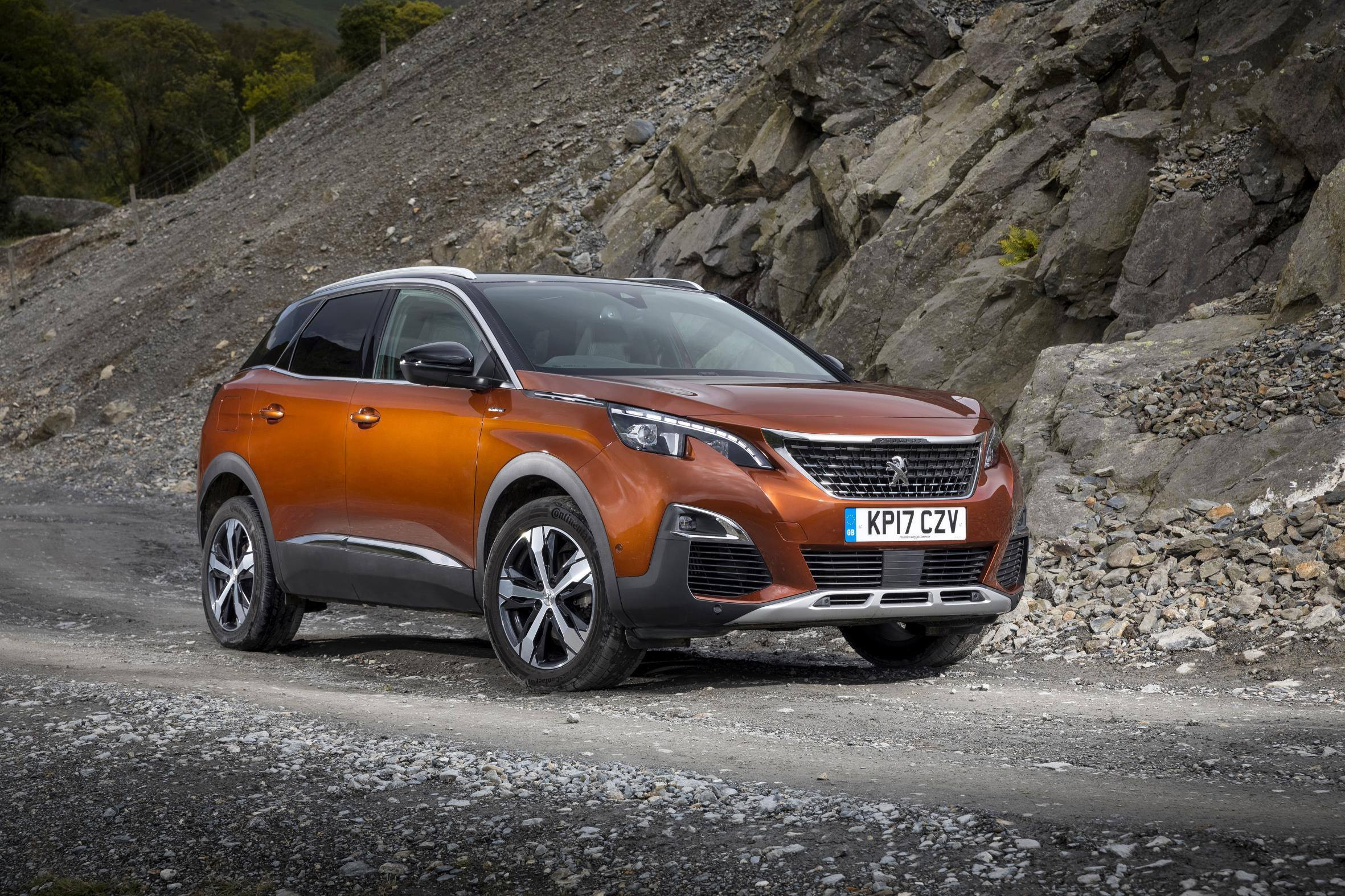 image of an orange peugeot 3008 car exterior