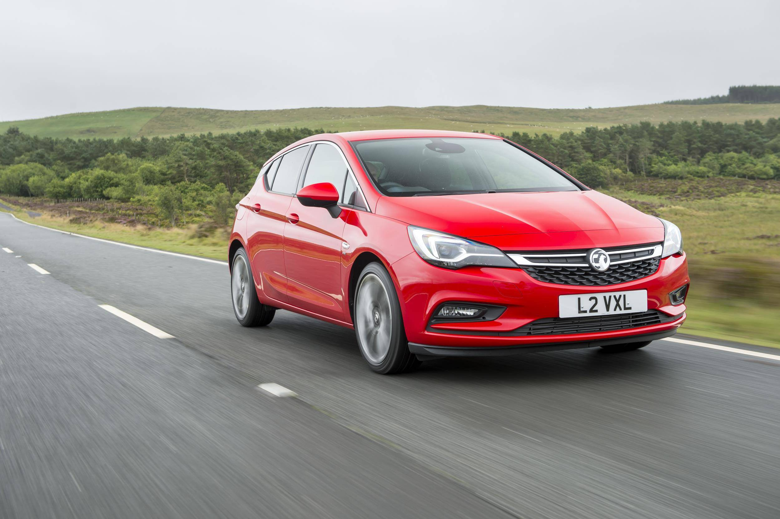 image of a red vauxhall astra car exterior