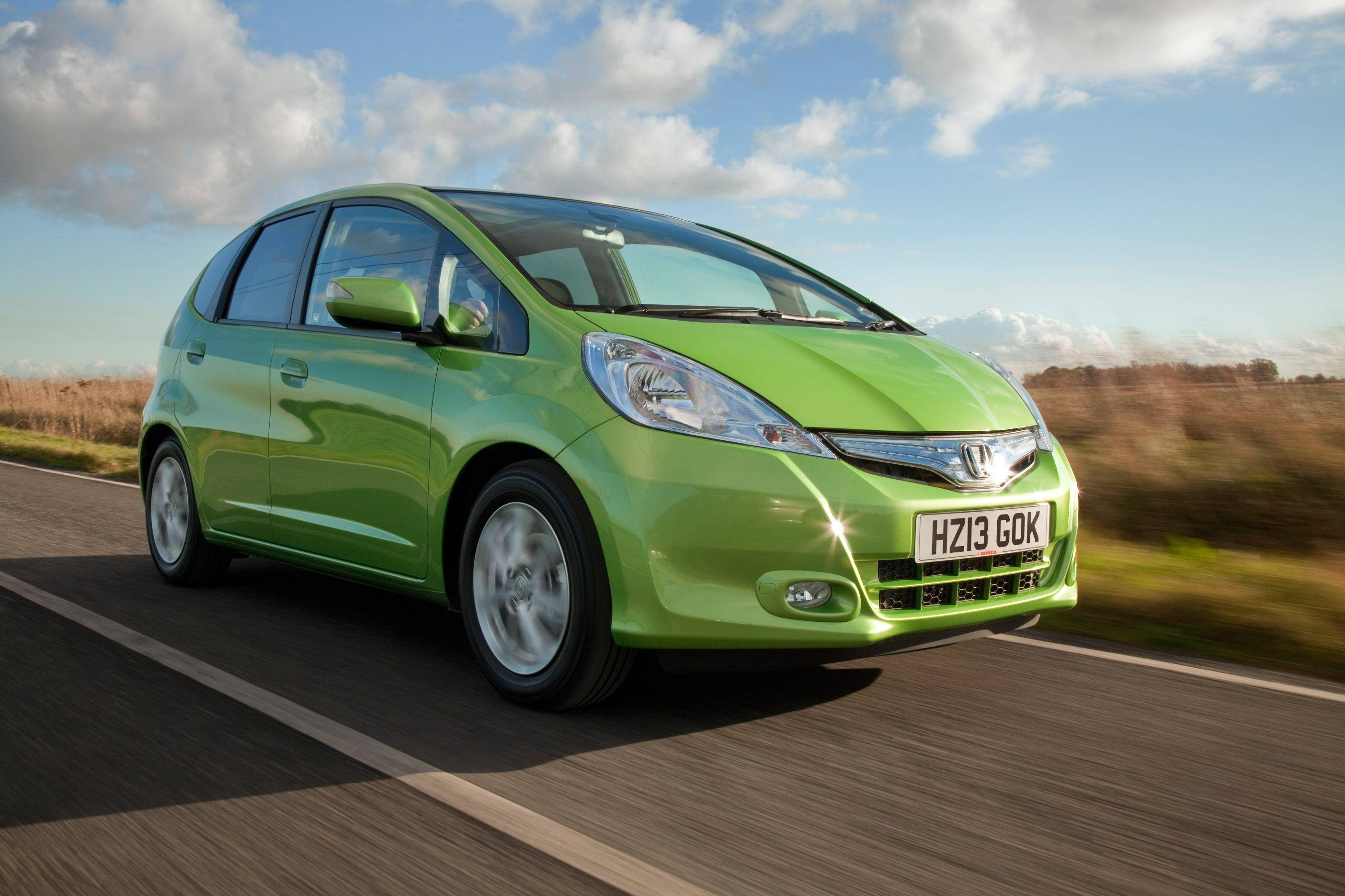 image of a green honda jazz hybrid car exterior