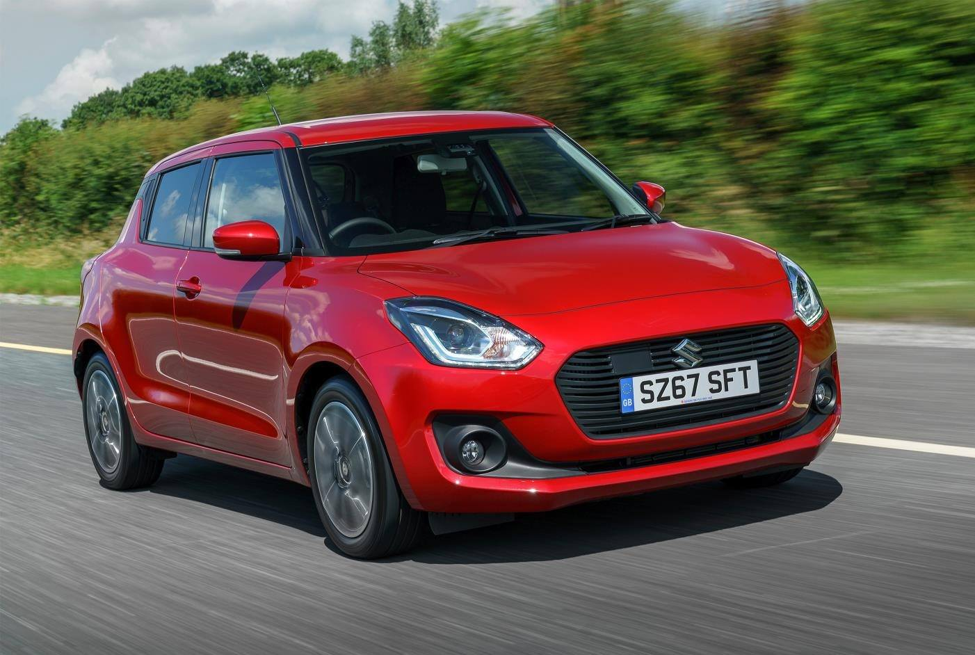 image of a red suzuki swift hybrid car exterior