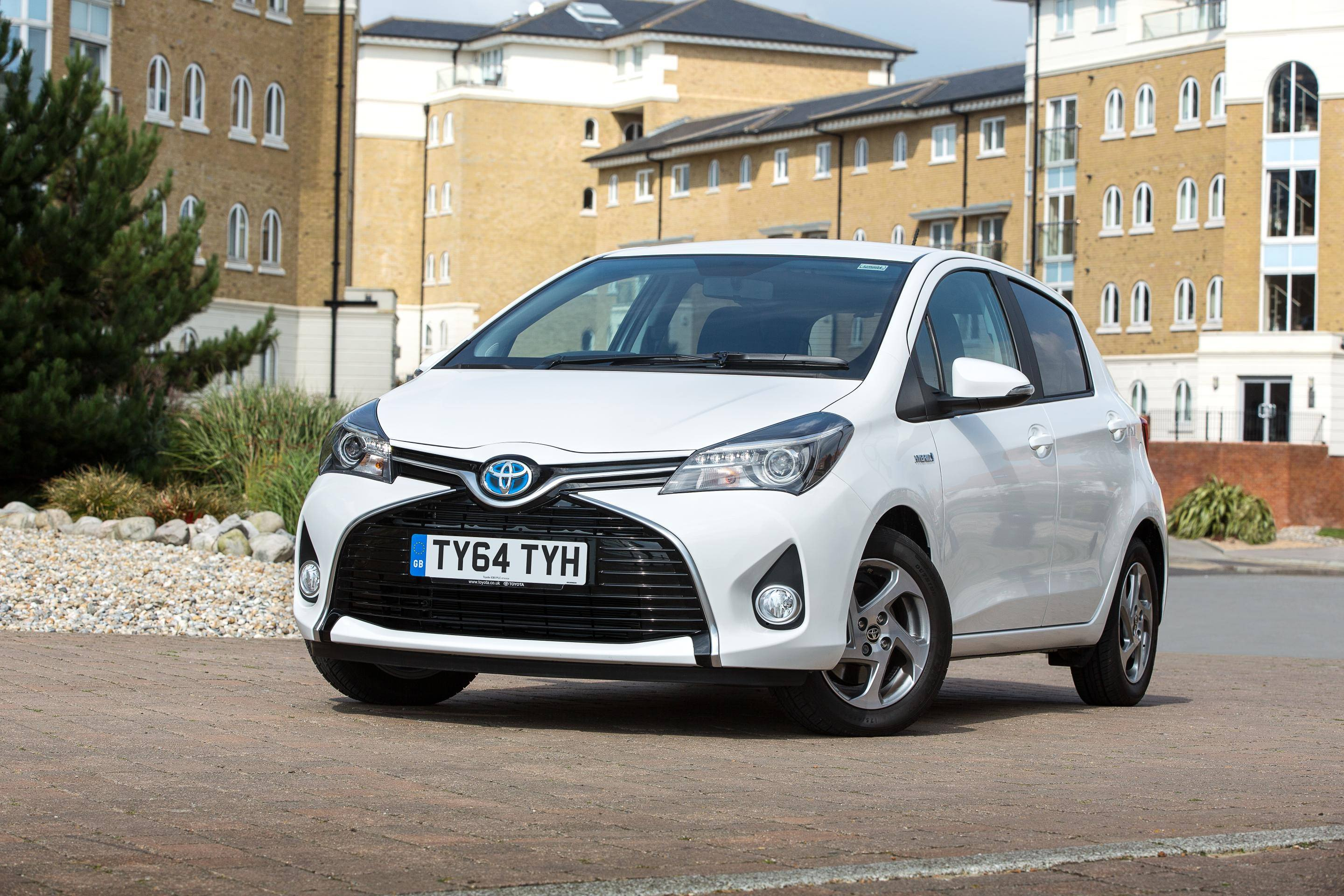 image of a white toyota yaris hybrid car exterior