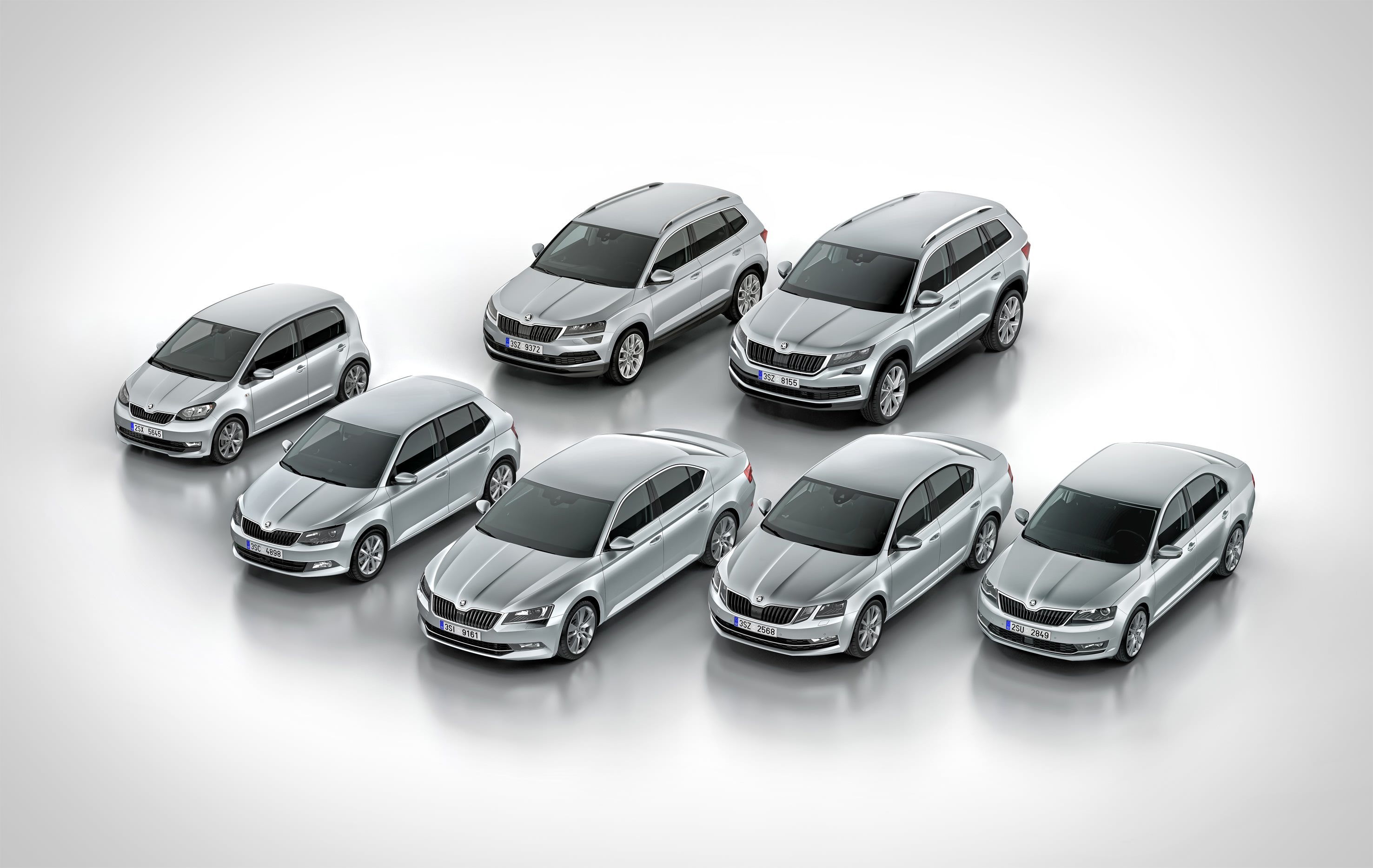 image of several various silver cars