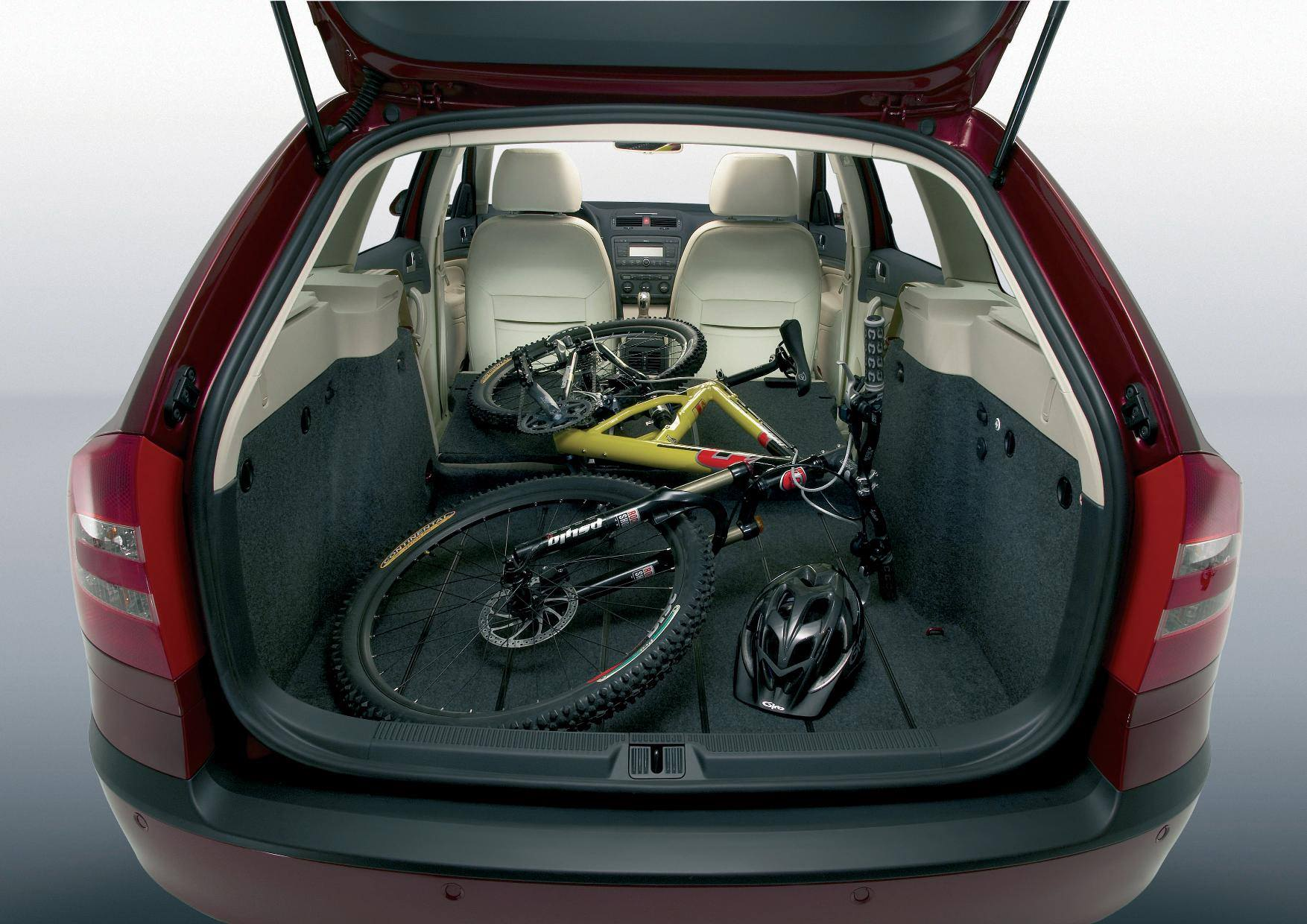 image of a red skoda octavia estate car with a bike in the boot