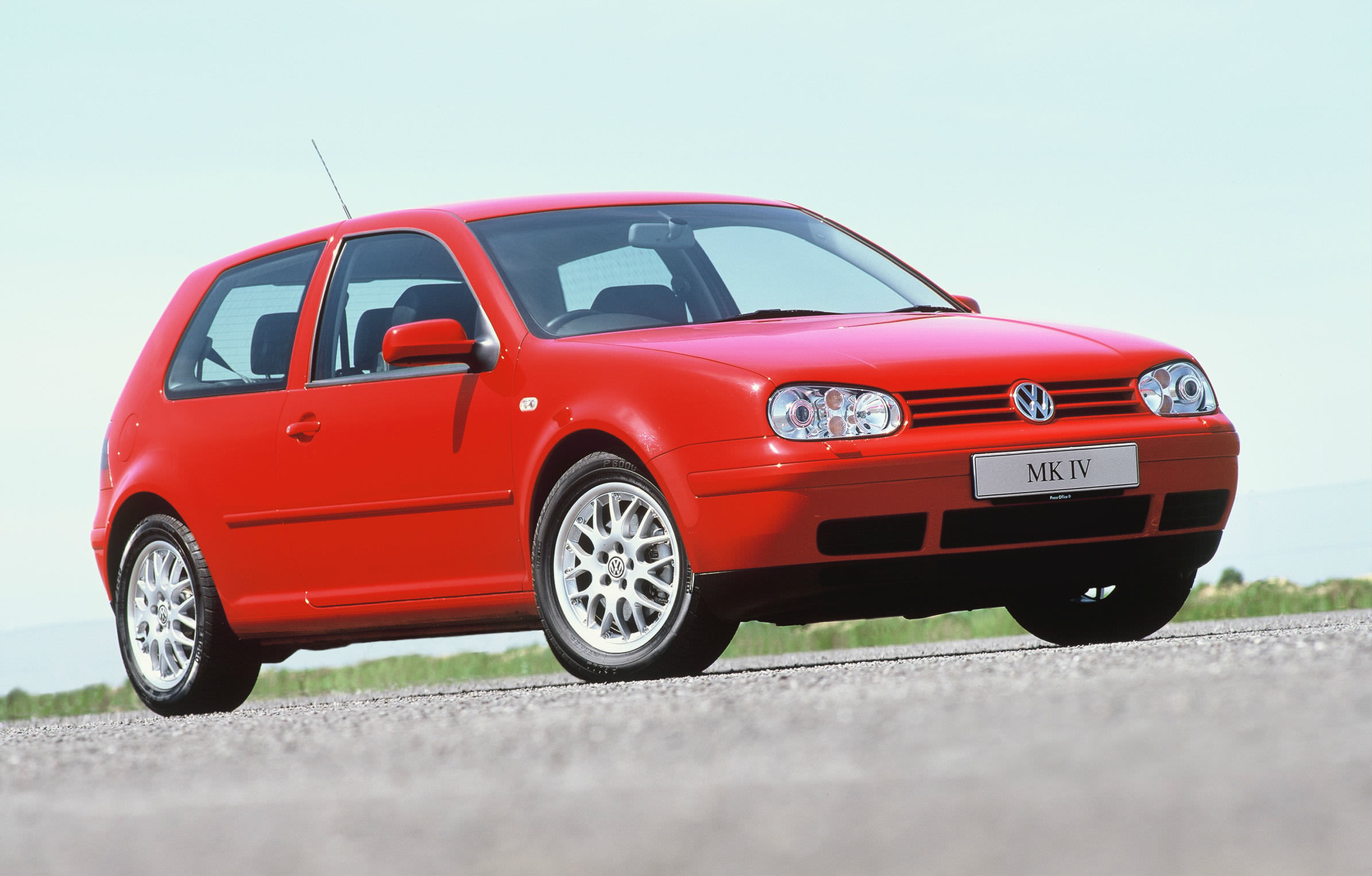 image of a red volkswagen golf gti car exterior