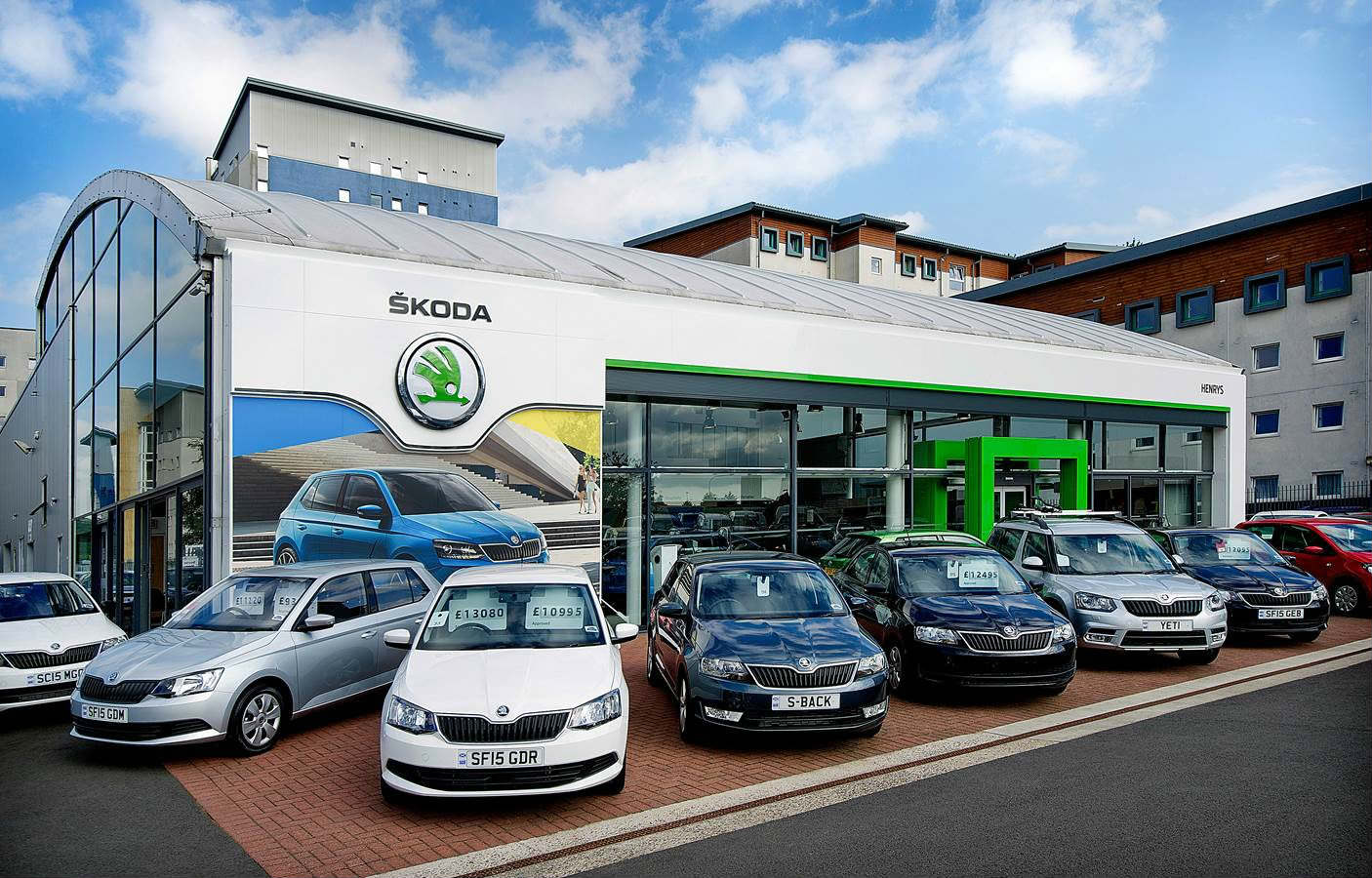 image of skoda cars parked on the lot of a skoda main dealership
