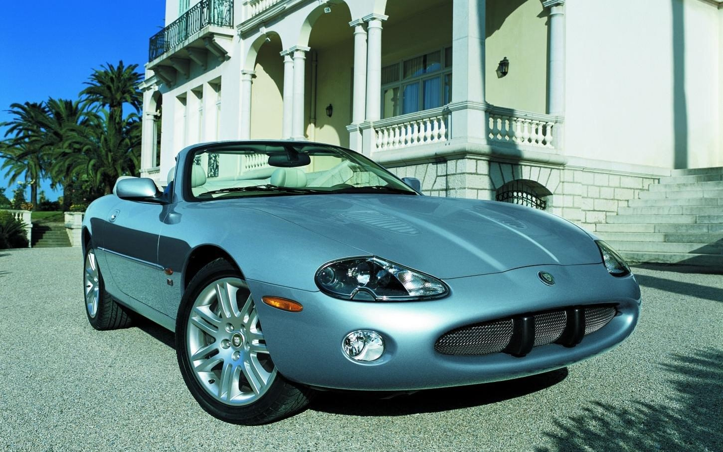 image of a blue jaguar xkr convertible car exterior