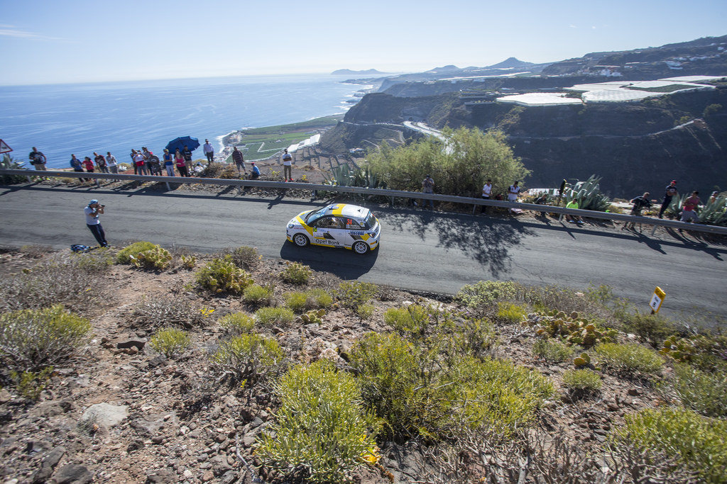 image of chris ingrams rally car going round a corner in a rally race