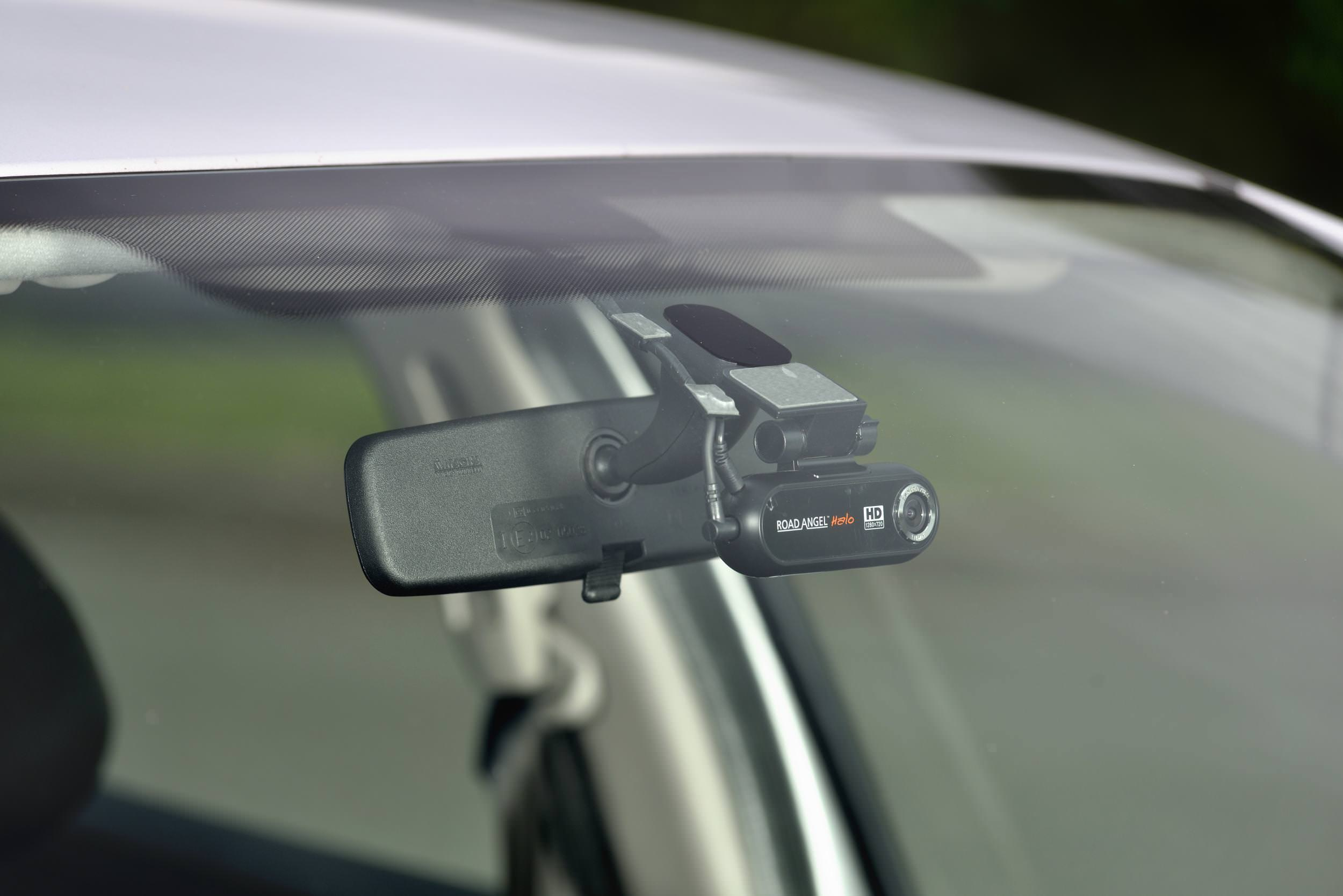 Dash Camera recording the road attached to a cars interior mirror