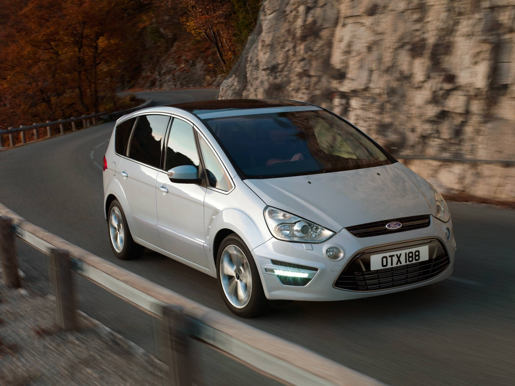 Silver Ford S-Max Driving aon mountain road