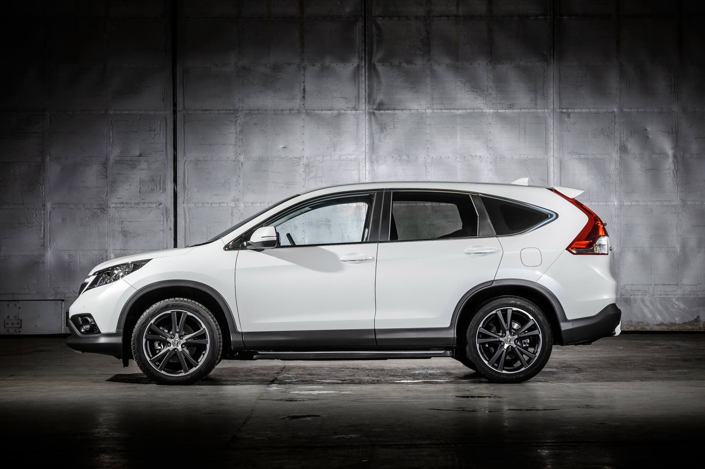 White Honda CR-V parked inside warehouse