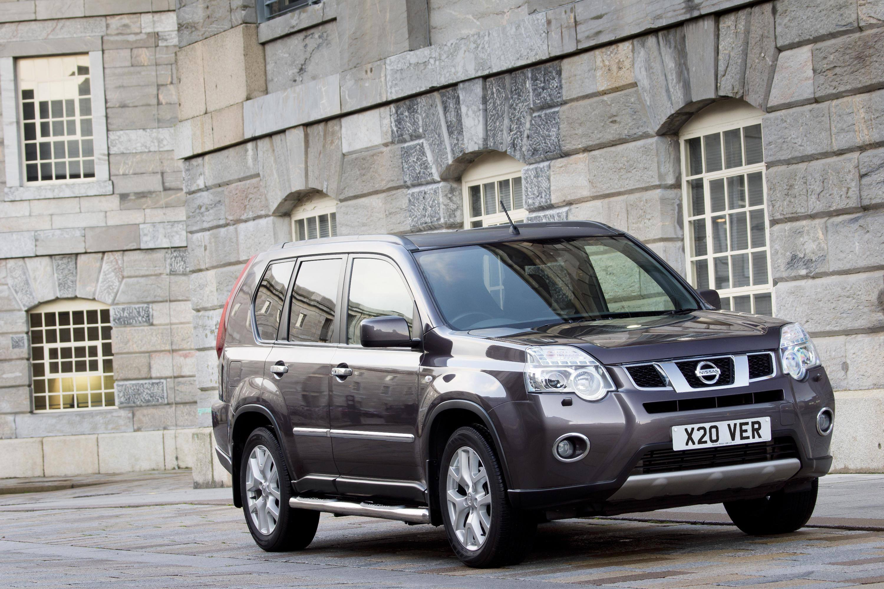 Grey Nissan X-trail parked outside castle