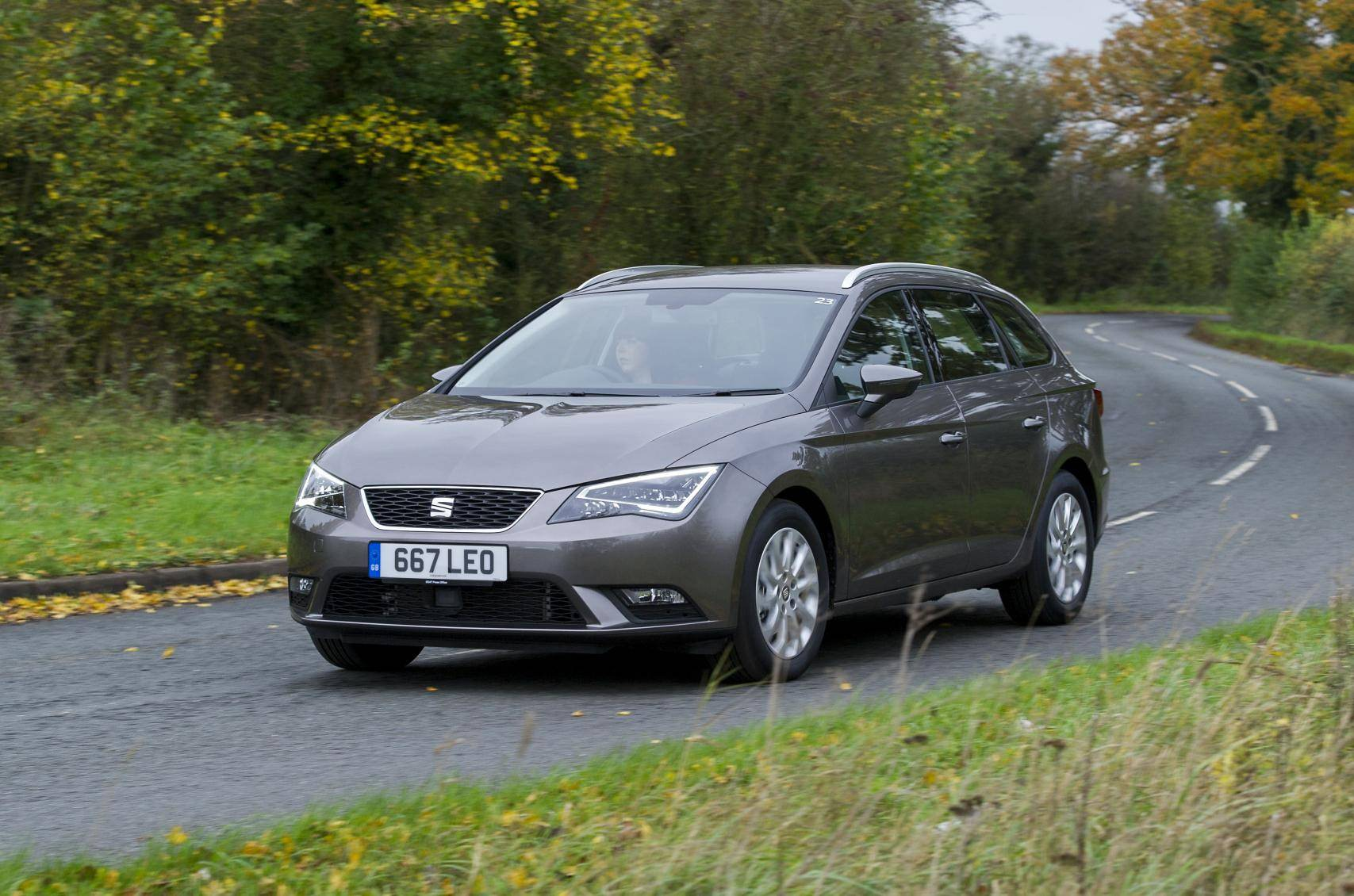 Grey Seat Leon driving on countryside road