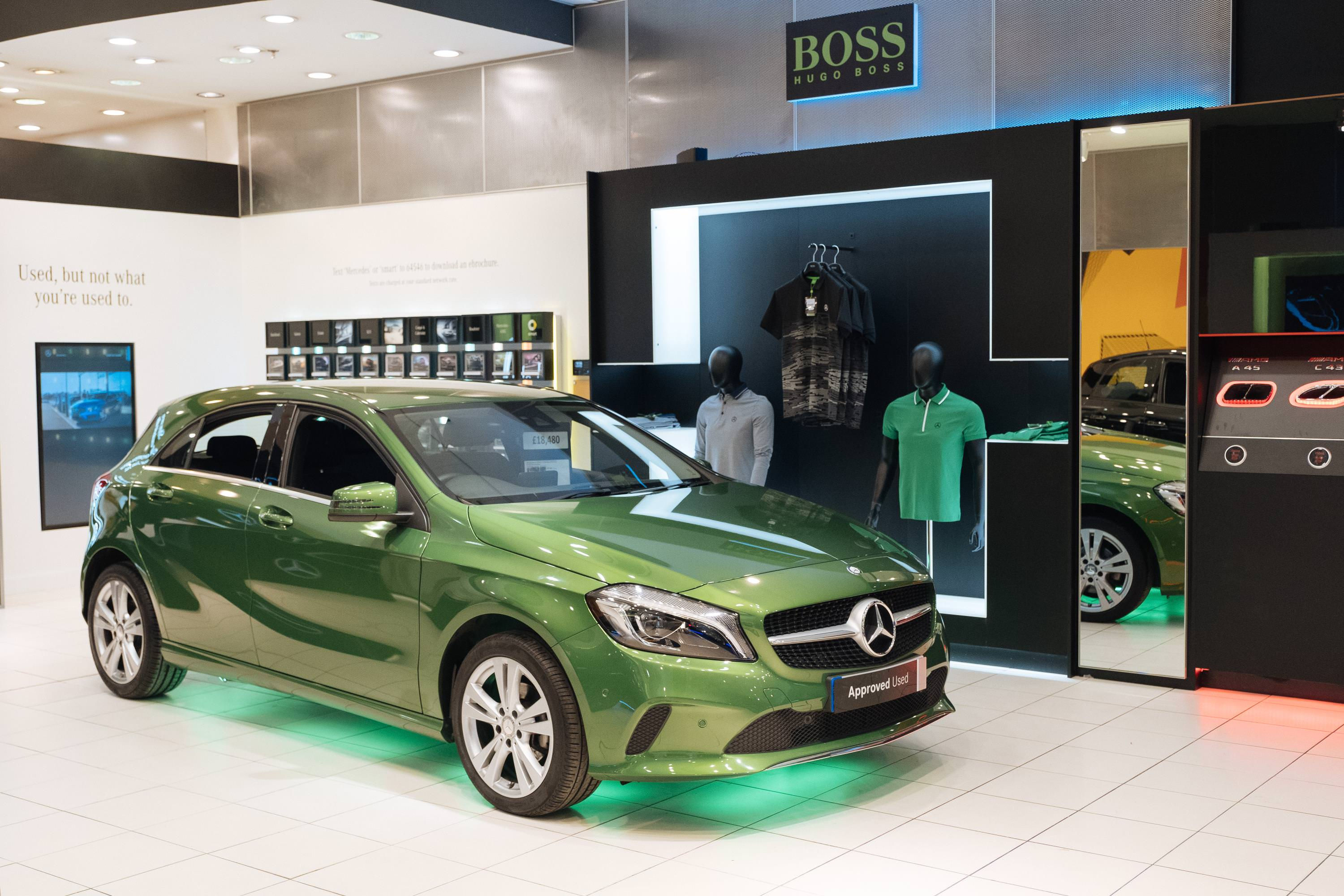 Candy Apple Green Mercedes parked inside retail shop