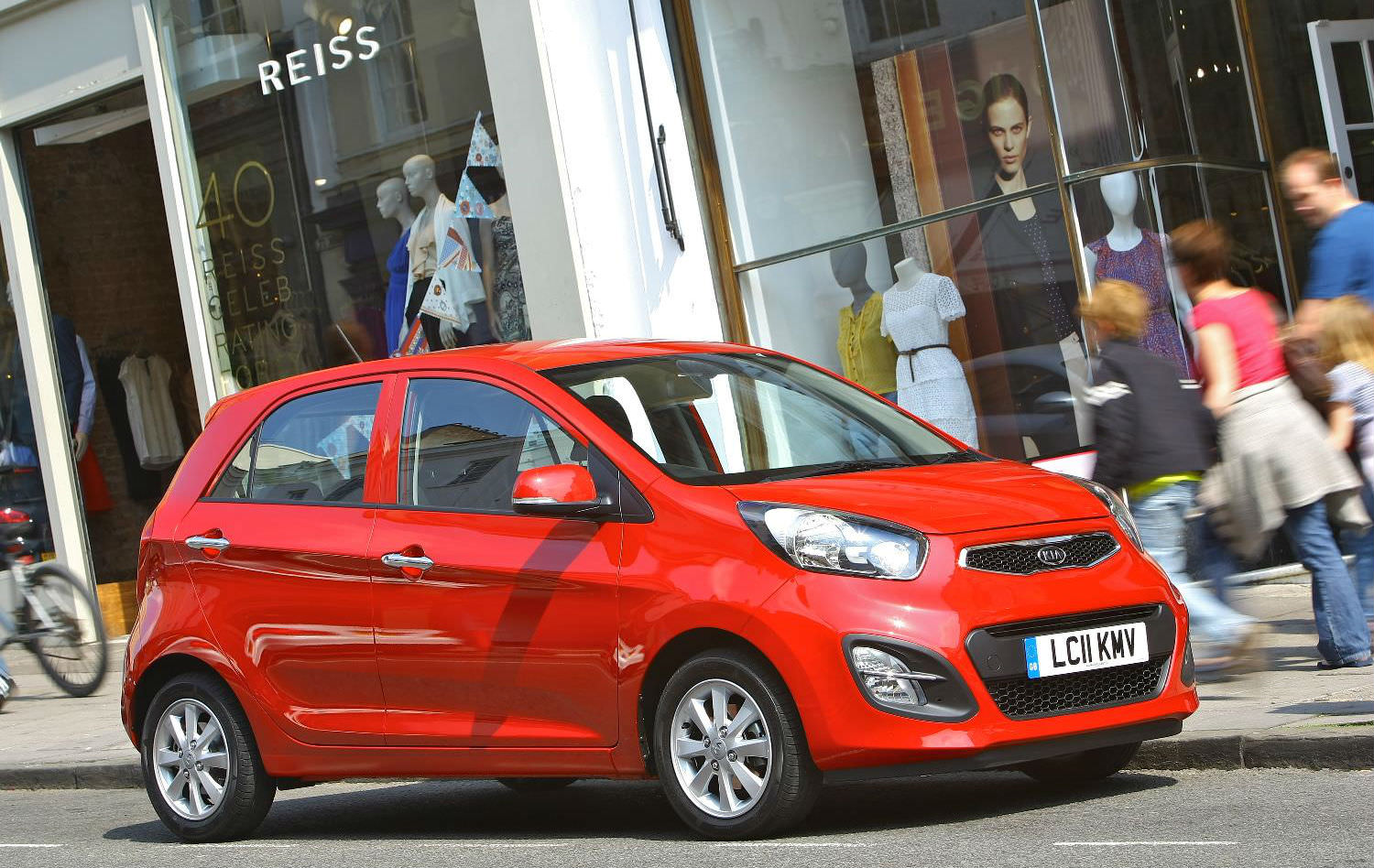 Used Kia Picanto driving down high-street
