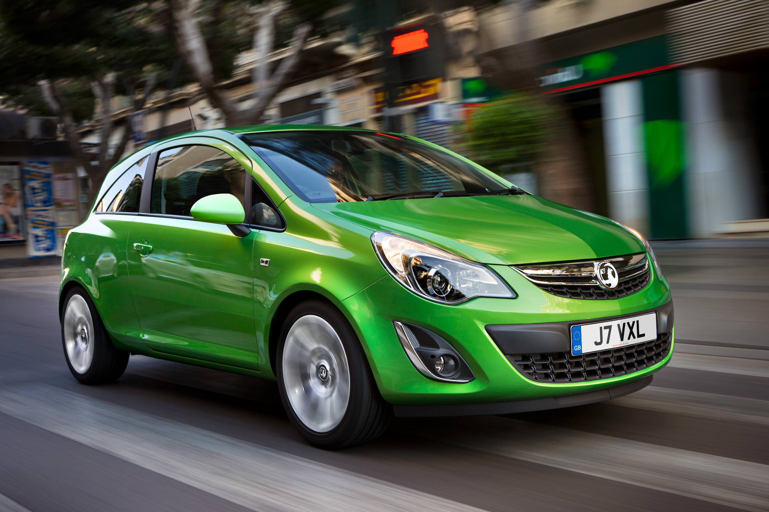 Used Candy Apple Green Vauxhall Corsa driving down high-street