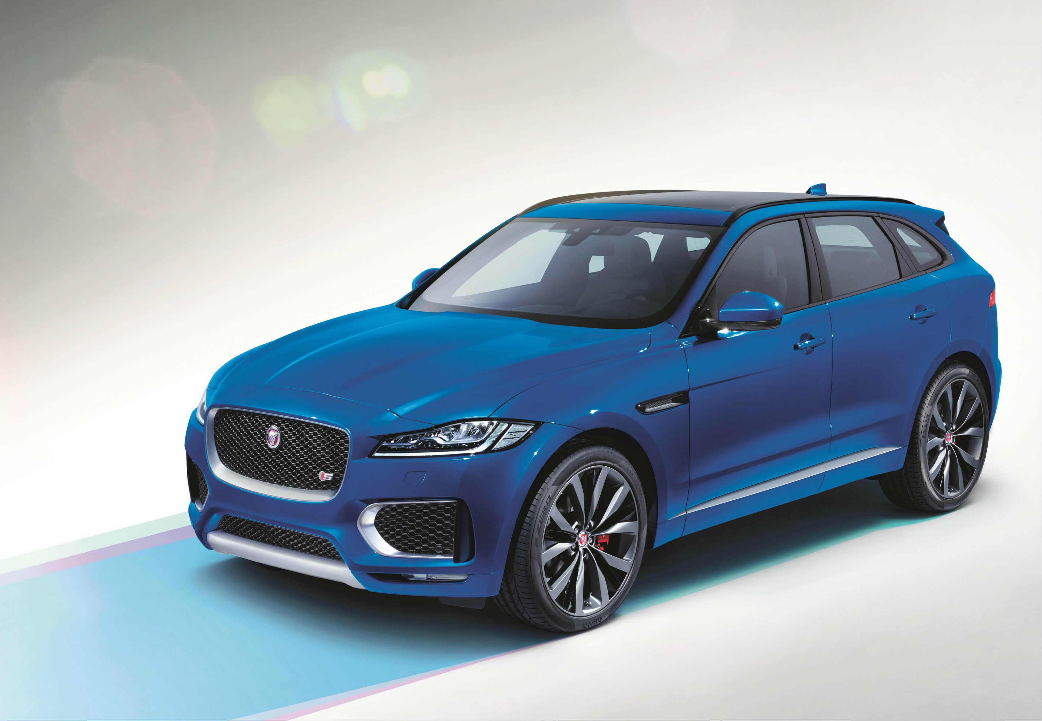 image of a blue jaguar f pace car exterior