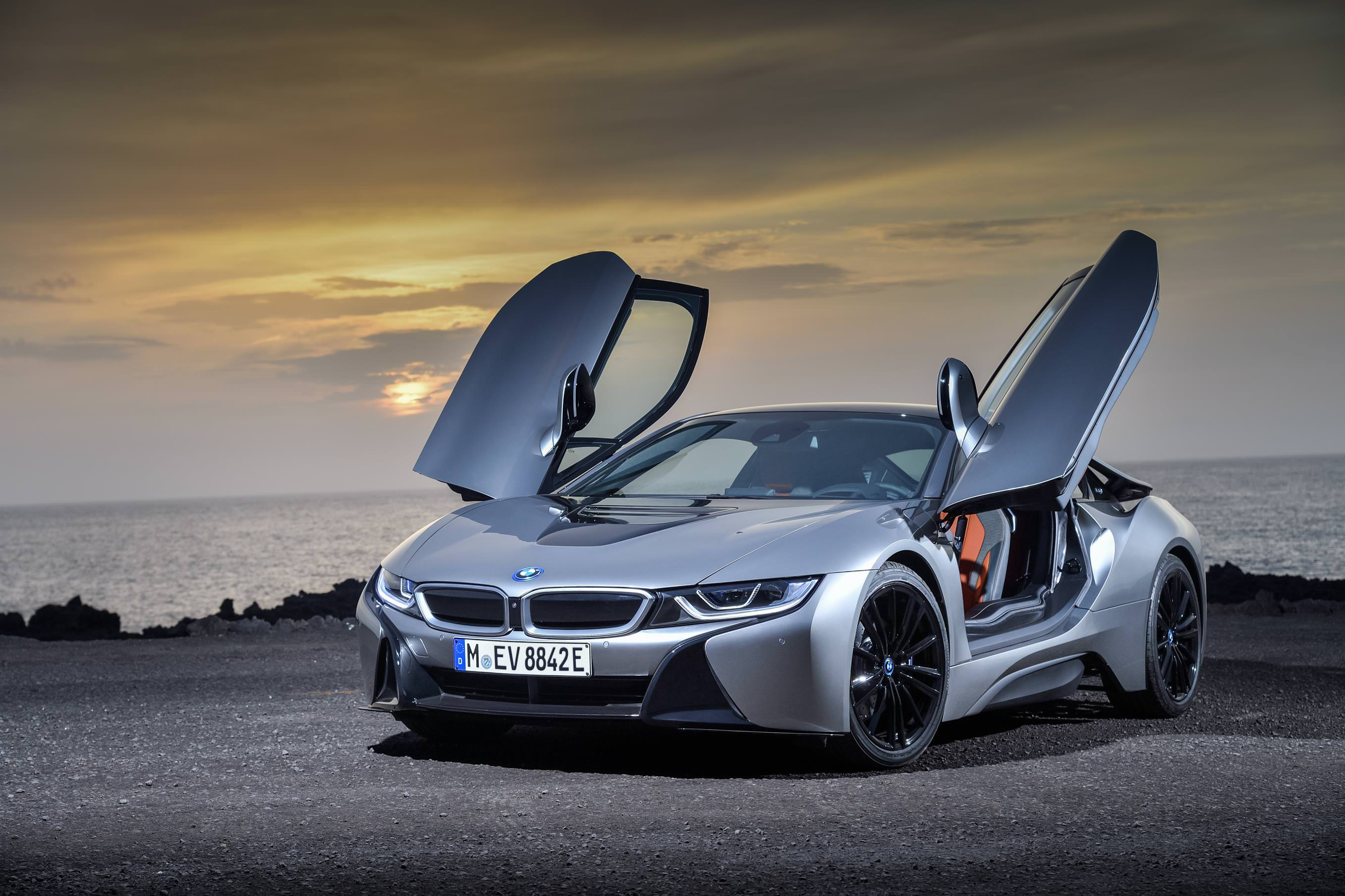 image of a bmw i8 car exterior with its doors open