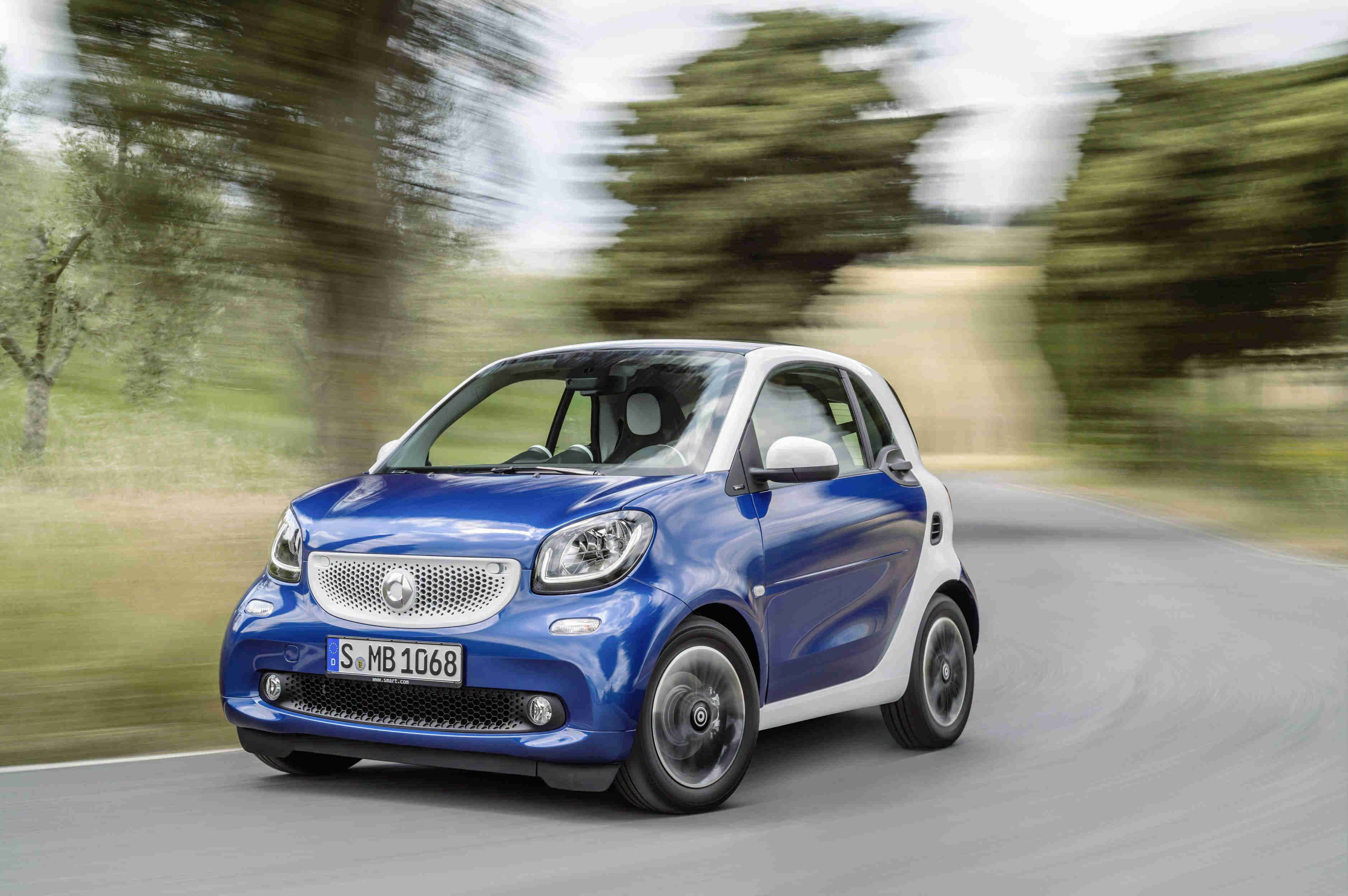 image of a blue and white smart city fortwo car exterior