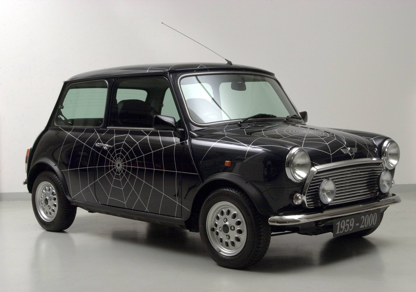 image of a black vintage mini cooper car exterior with spider web design