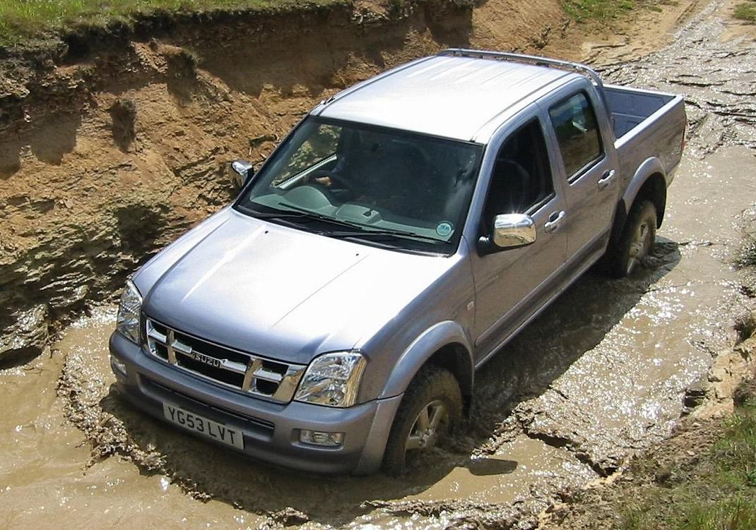 Silver Chevrolet TFR driving across muddy terrain