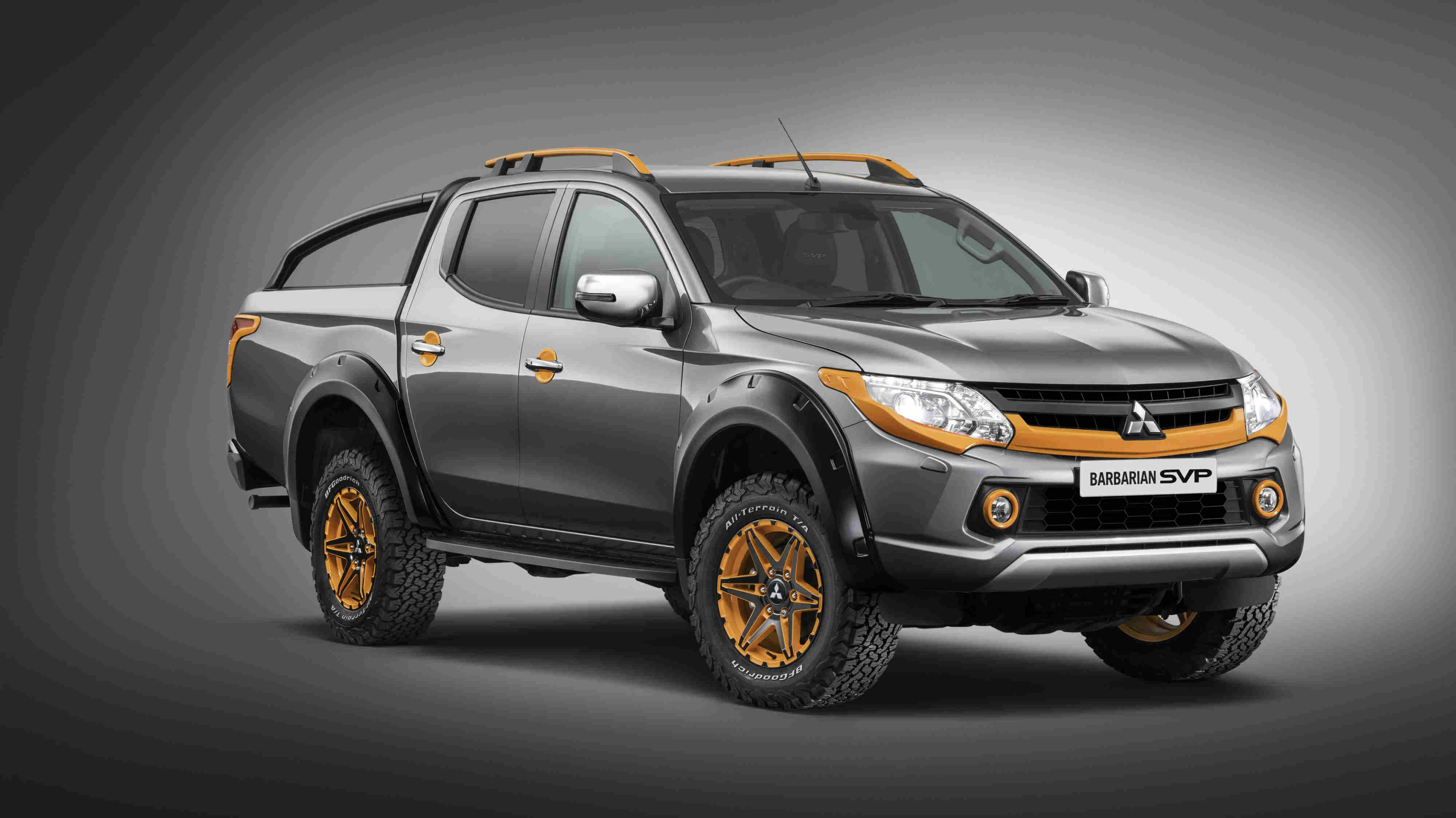 image of a grey and orange mitsubishi l200 barbarian car exterior