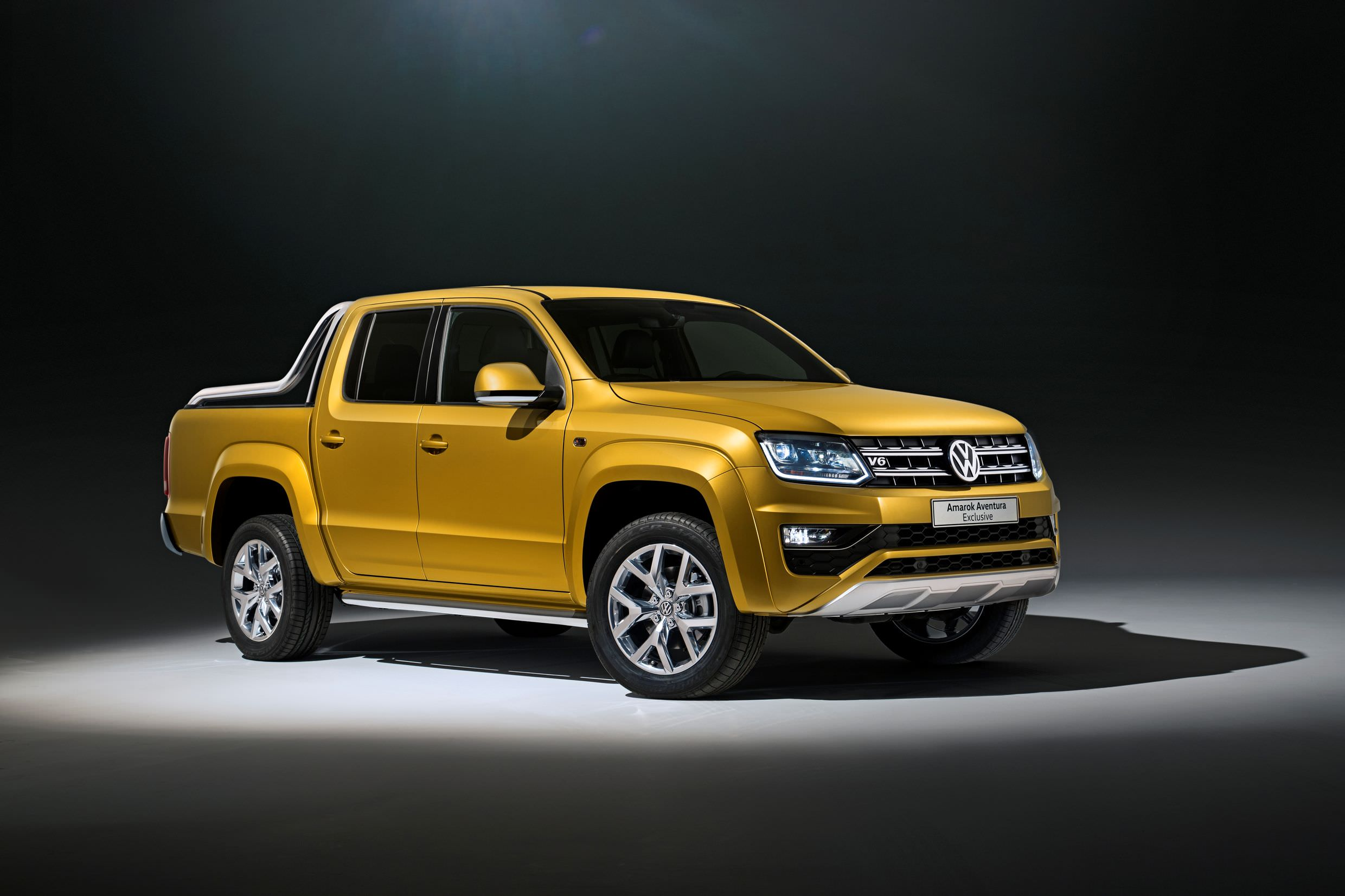 image of a yellow volkswagen amarok car exterior