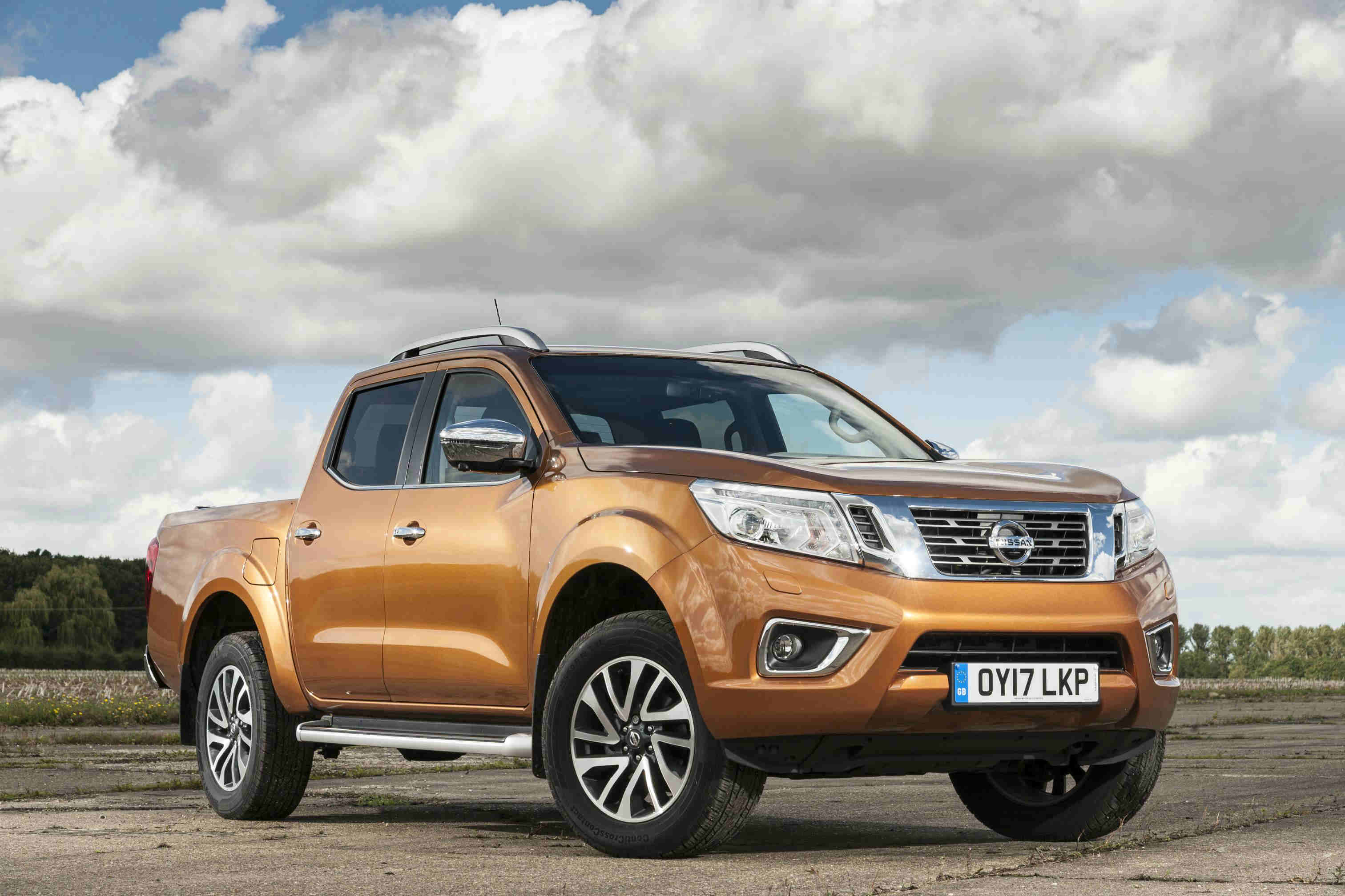 image of an orange nissan navara car exterior