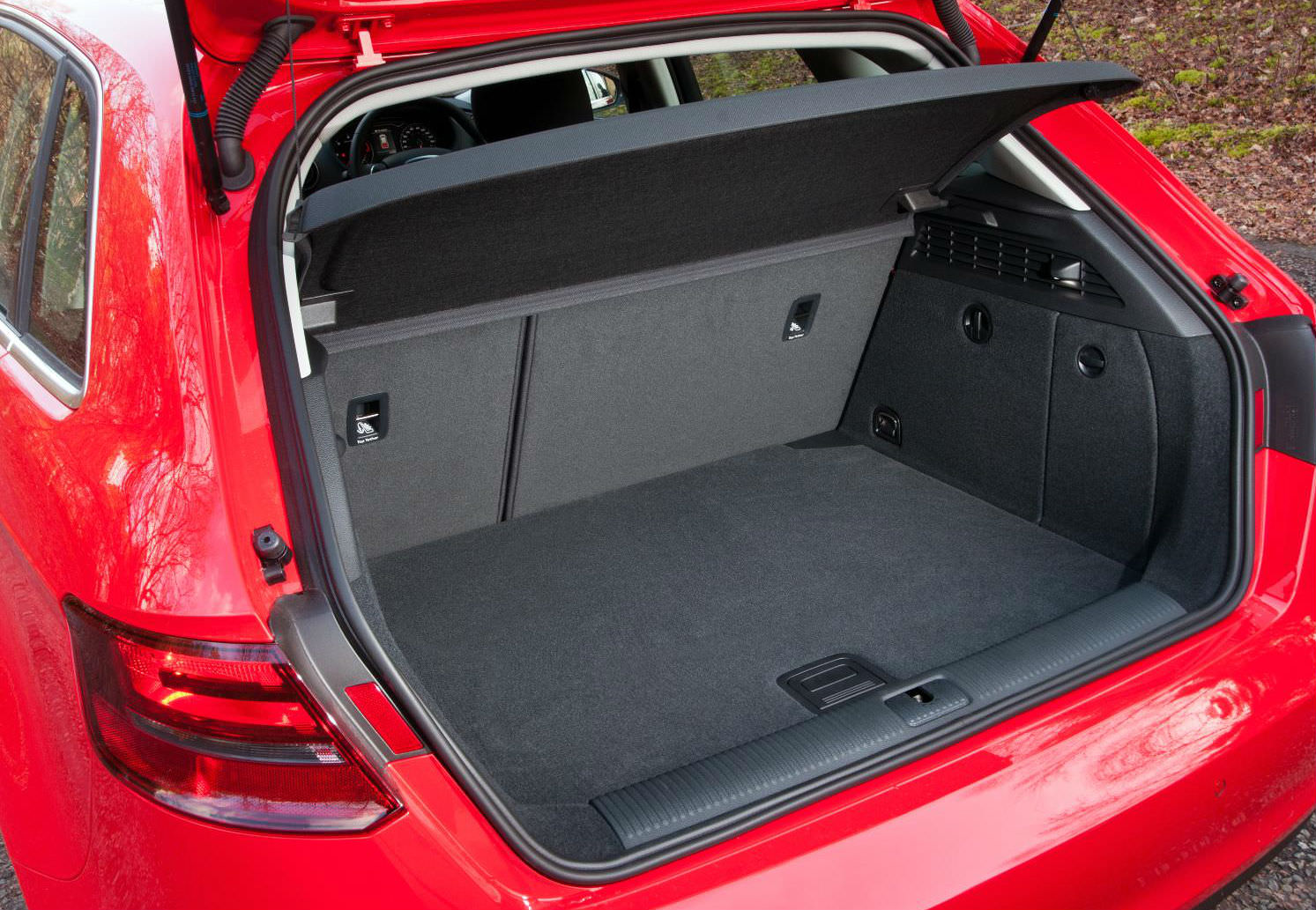 image of a red audi a3 sportback car exterior with boot open