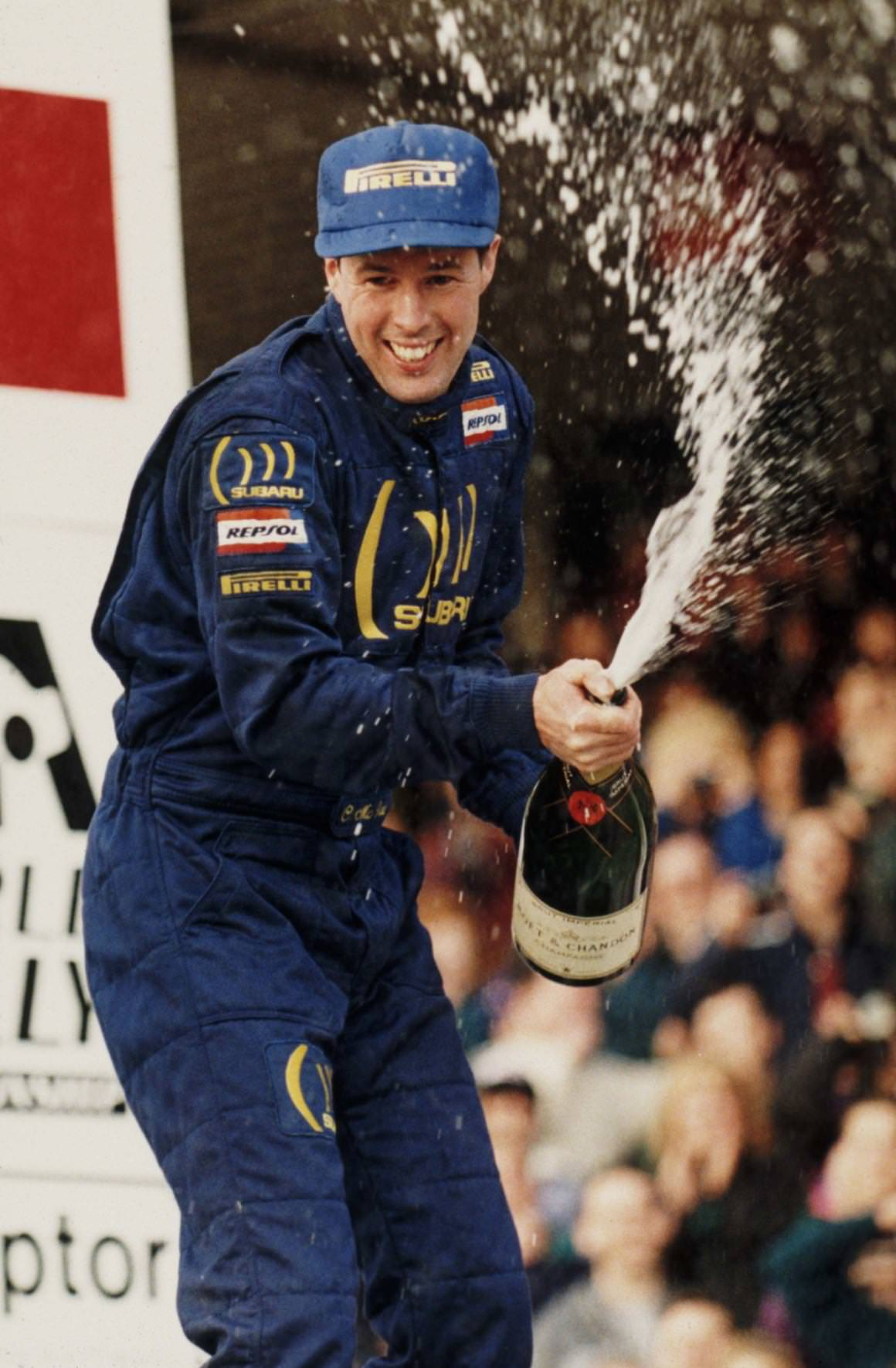 Colin McRae sprays champagne after winning the WRC title in 1995