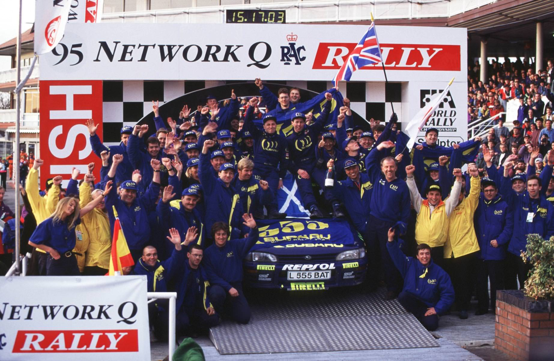 image of colin mcrae and subaru team on the winners podium in 1995