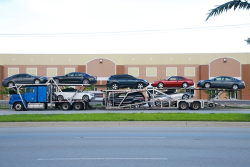 Car carrier near a business