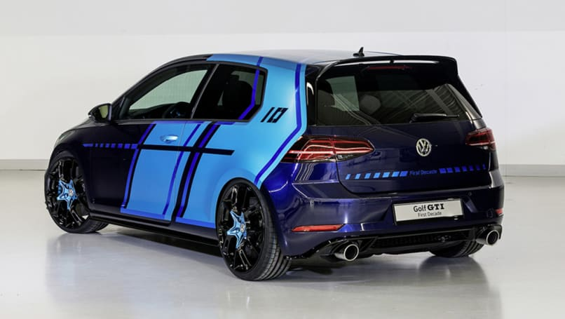 The two-door Golf is painted in Atlantic Blue Metallic and the doors and rear side panels have large areas of foil in the contrasting colour of Satin Ocean Shimmer.