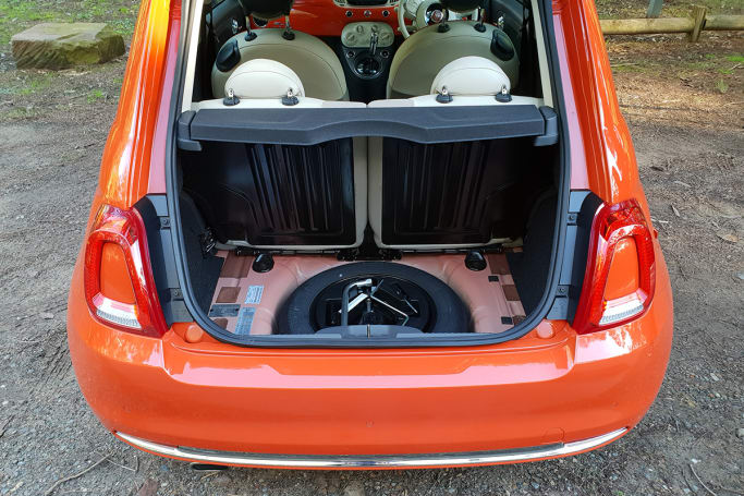 a temporary space-saver spare wheel lies underneath the floor of the  185-litre