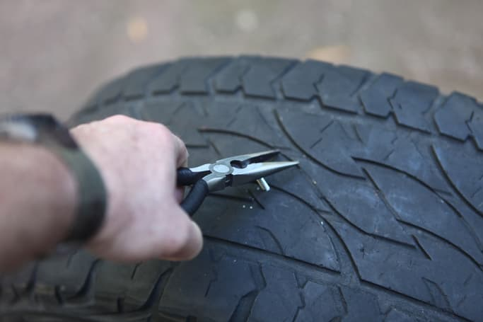 how to use a tyre puncture repair kit carsguide