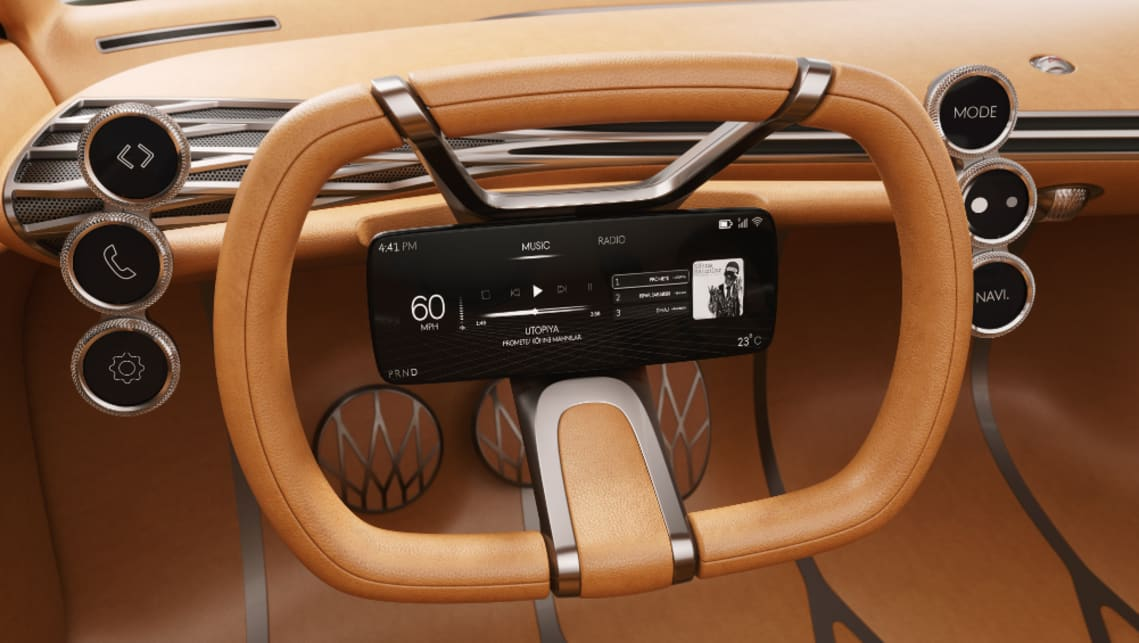 There's no centre console with controls mounted alongside the steering wheel and information is displayed on six individual screens.