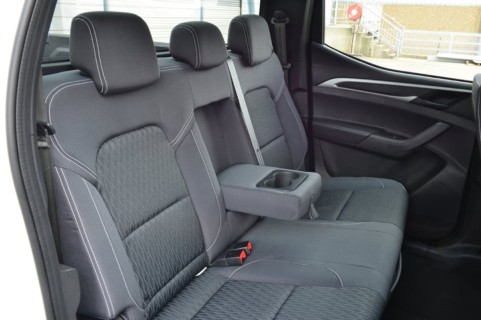 Rear passengers get door pockets, a centre armrest with two cupholders and a 12V socket.