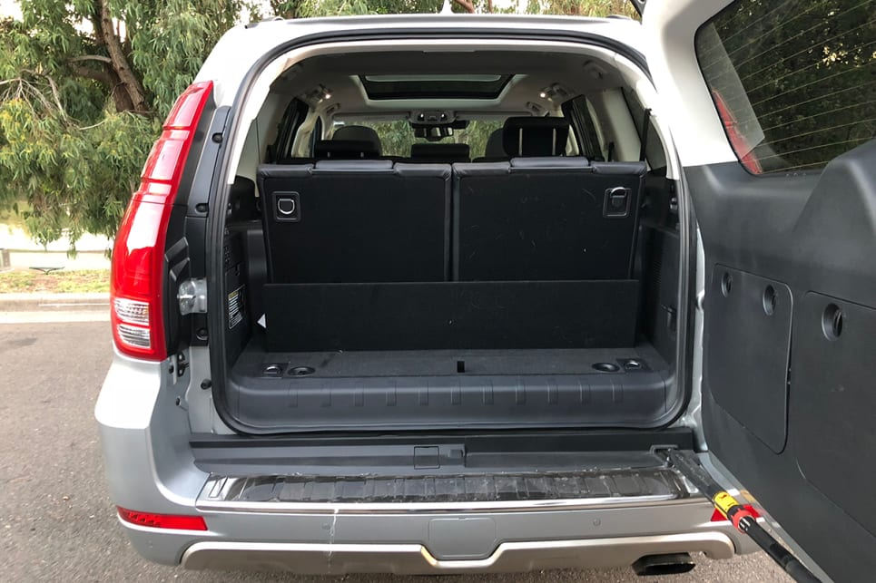 The side-hinged boot opens to reveal a laughably small storage space with the third row in place.