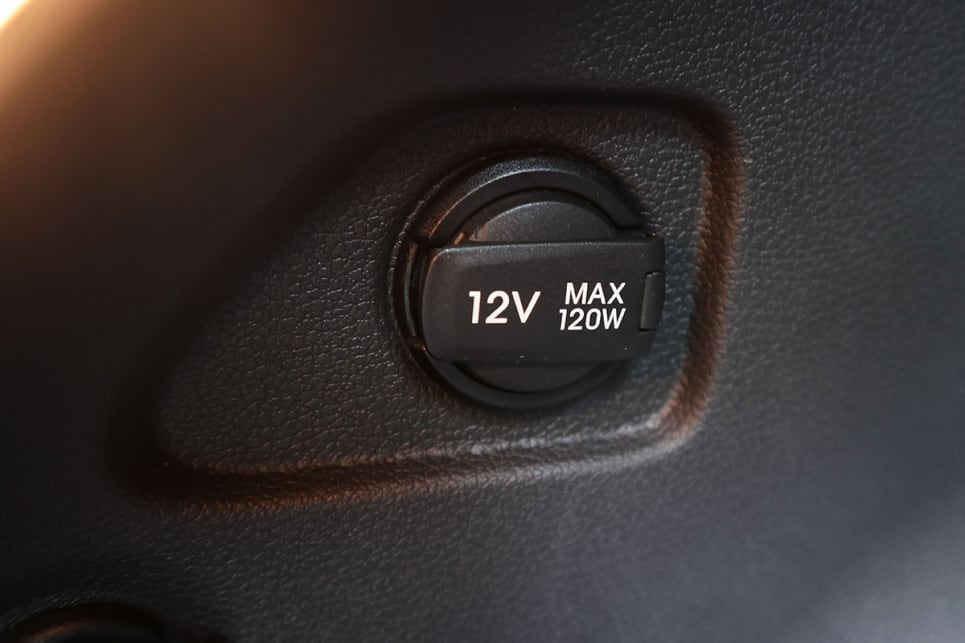 While it does miss out on rear charging points, the Tucson has a 12-volt socket in the cargo area. (image credit: Tim Robson)