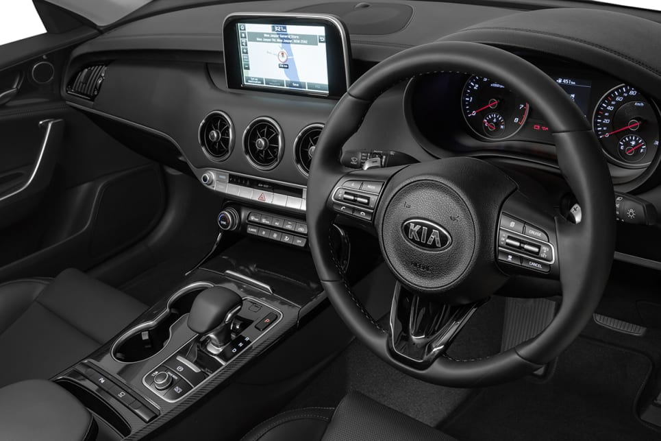 The Si versions come with real cow seats and a larger 8.0-inch multimedia screen. (2018 Kia Stinger 300Si)