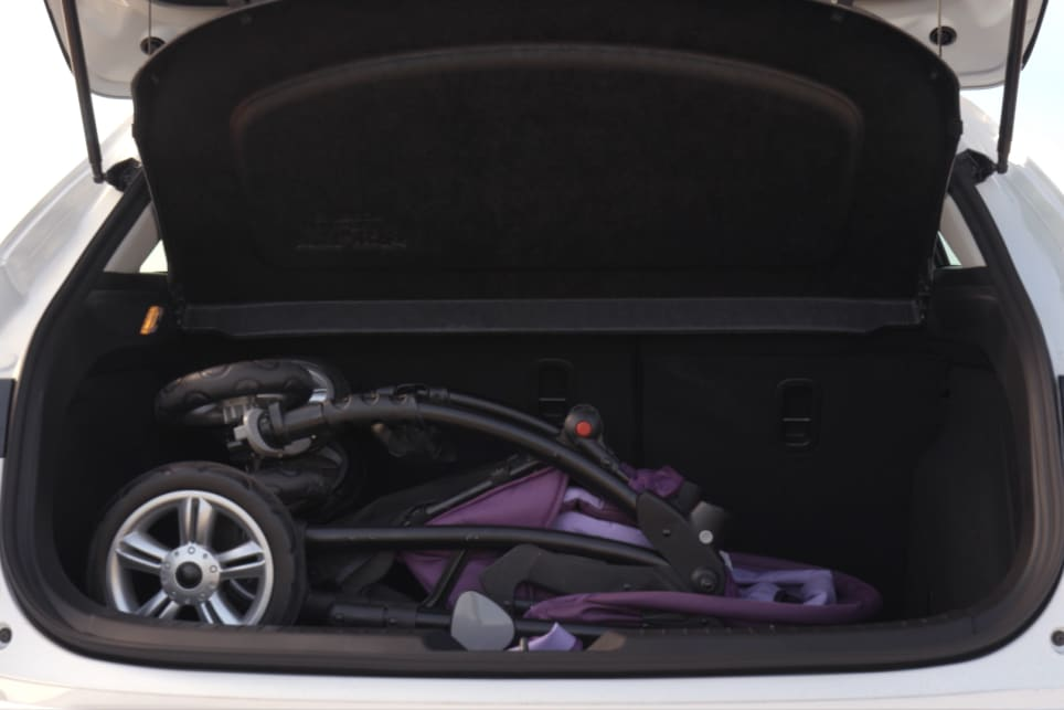 The 3 has a still-small-for-the-class 308L cargo capacity, but the pram was an easier fit.