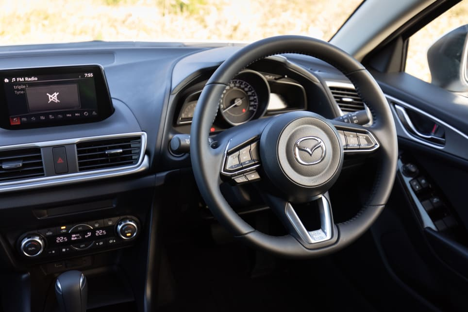 While the Mazda's steering offers lots of feel, the wheel can jostle in your hand over bumpy bits.