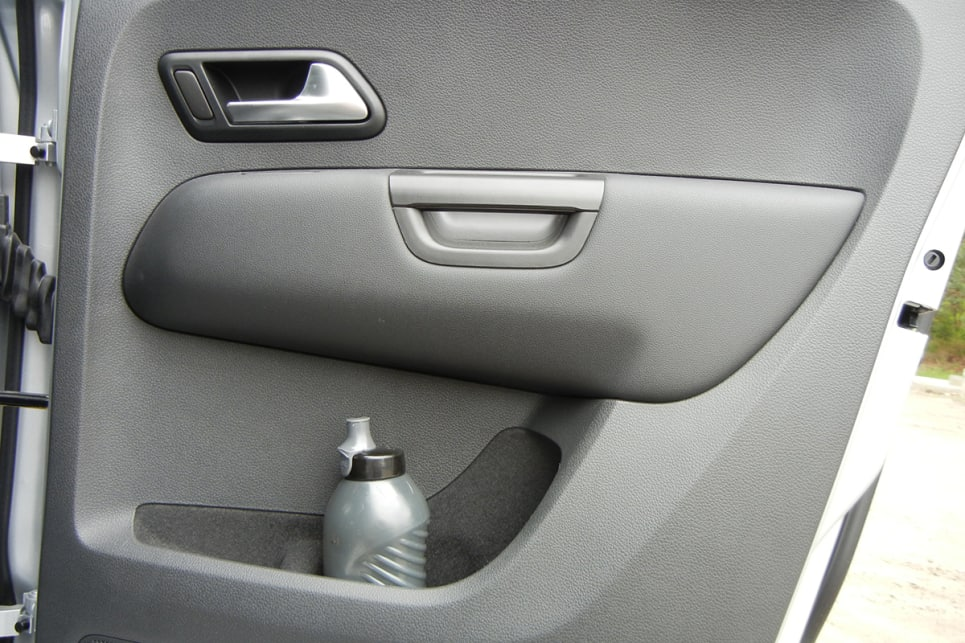 Rear seat passengers get bottle holders and storage pockets in each door, plus two more bottle/cup holders in the centre.