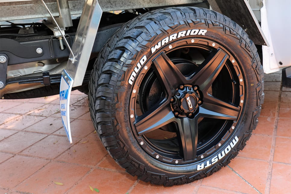 The dealership added black 20-inch wheels with mud terrain tyres on it.